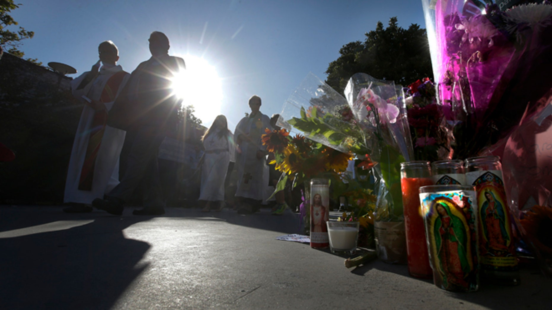 Family and friends march to Santa Monica College Corsair football stadium Monday, June 10, 2013, during a vigil for the five people killed in Friday's shootings in Santa Monica, Calif.  (AP Photo/Chris Carlson)