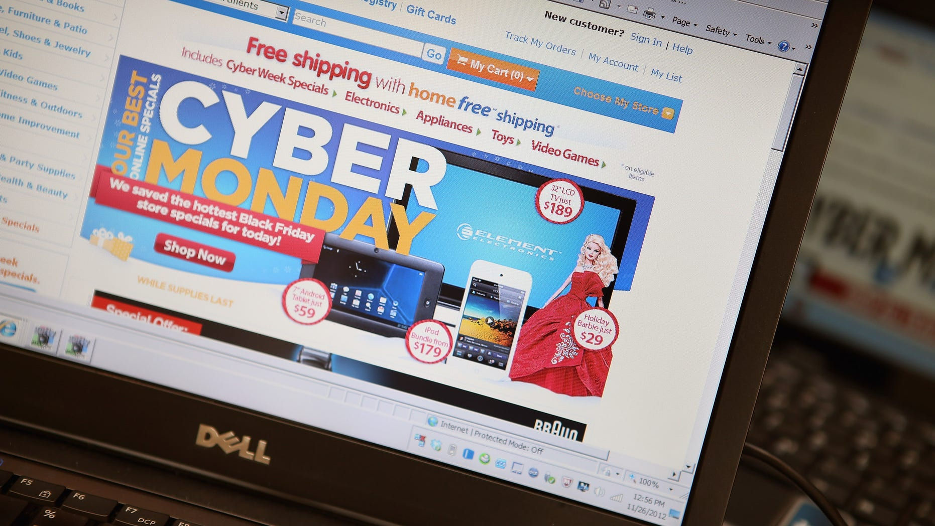 CHICAGO, IL - NOVEMBER 26:  In this photo illustration, a retailer advertises Cyber Monday deals on their websites on November 26, 2012 in Chicago, Illinois. Americans are expected to spend $1.5 billion while shopping online today, up 20 percent from last year.  (Photo Illustration by Scott Olson/Getty Images)