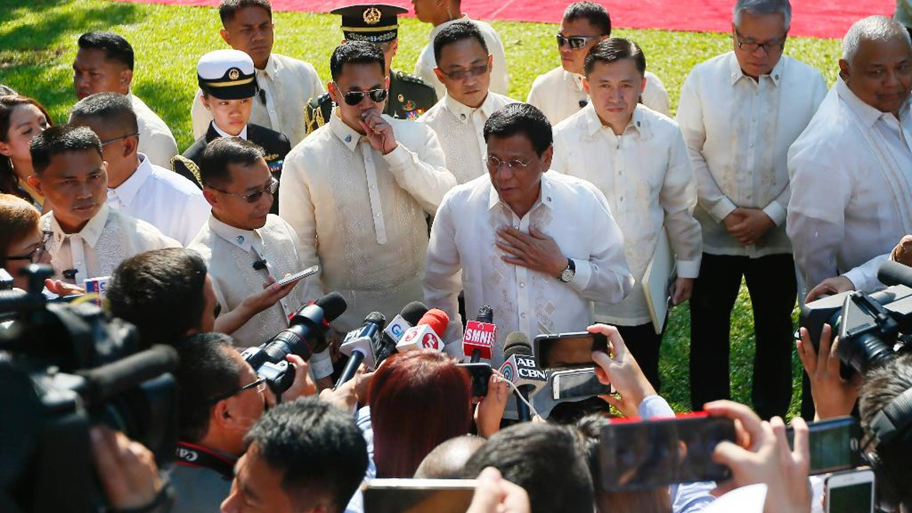 Philippine President Rodrigo Duterte talks to the media prior to a welcoming ceremony for Indonesian President Joko Widodo, at Malacanang Palace grounds in Manila, Philippines Friday, April 28, 2017. When Duterte hosts a summit of Southeast Asian leaders this weekend, the spotlight will be on him. Just less than a year in power, Duterte faces a mass murder complaint before the International Criminal Court and an impeachment bid at home as bodies continue to pile up in his war on illegal drugs.(AP Photo/Bullit Marquez)