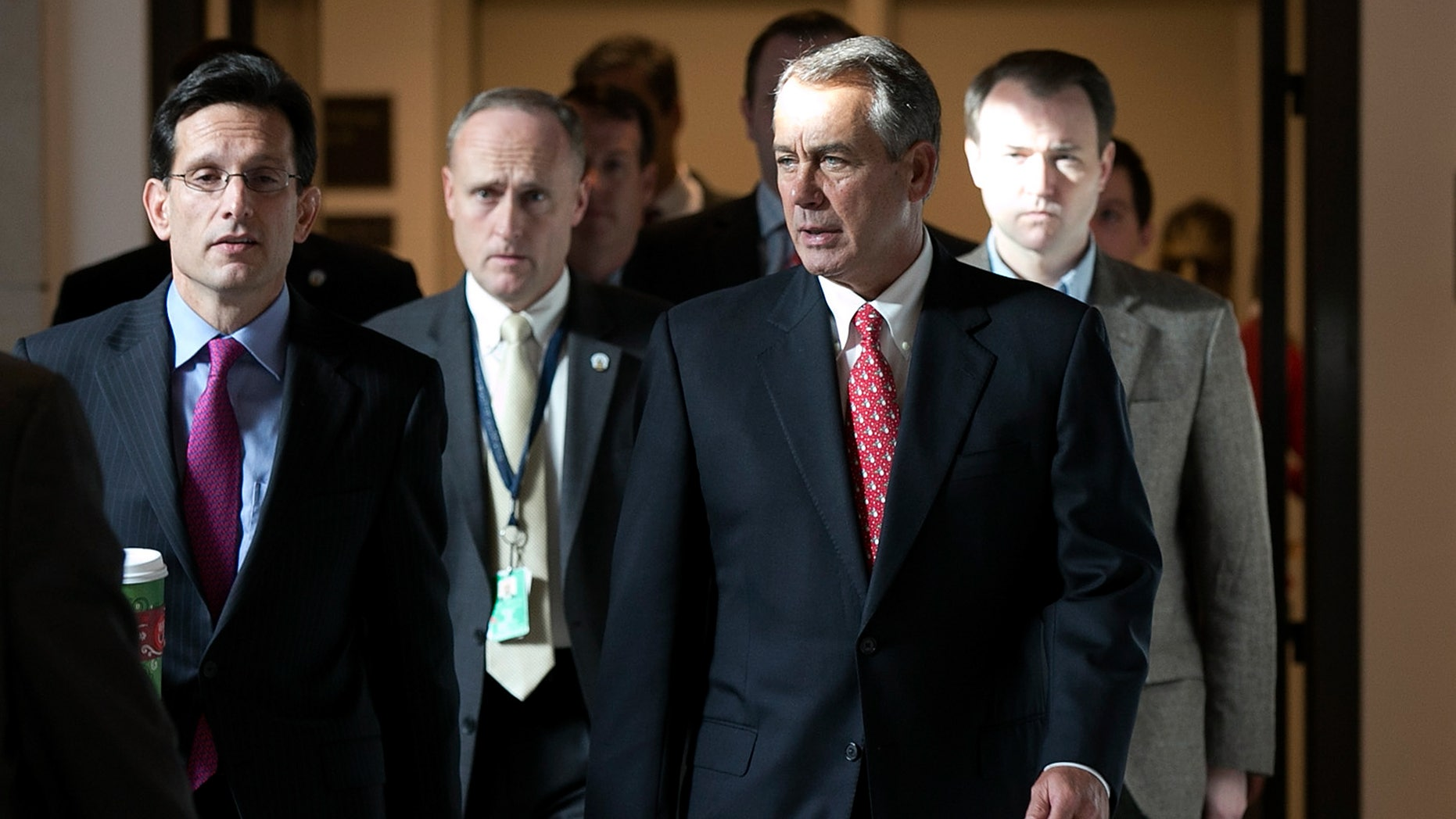 Speaker of the House John Boehner (R-OH) (2nd R) walks to a press conference with House Majority Leader Eric Cantor (R-VA) (L) at the U.S. Capitol December 21, 2012 in Washington, DC. )