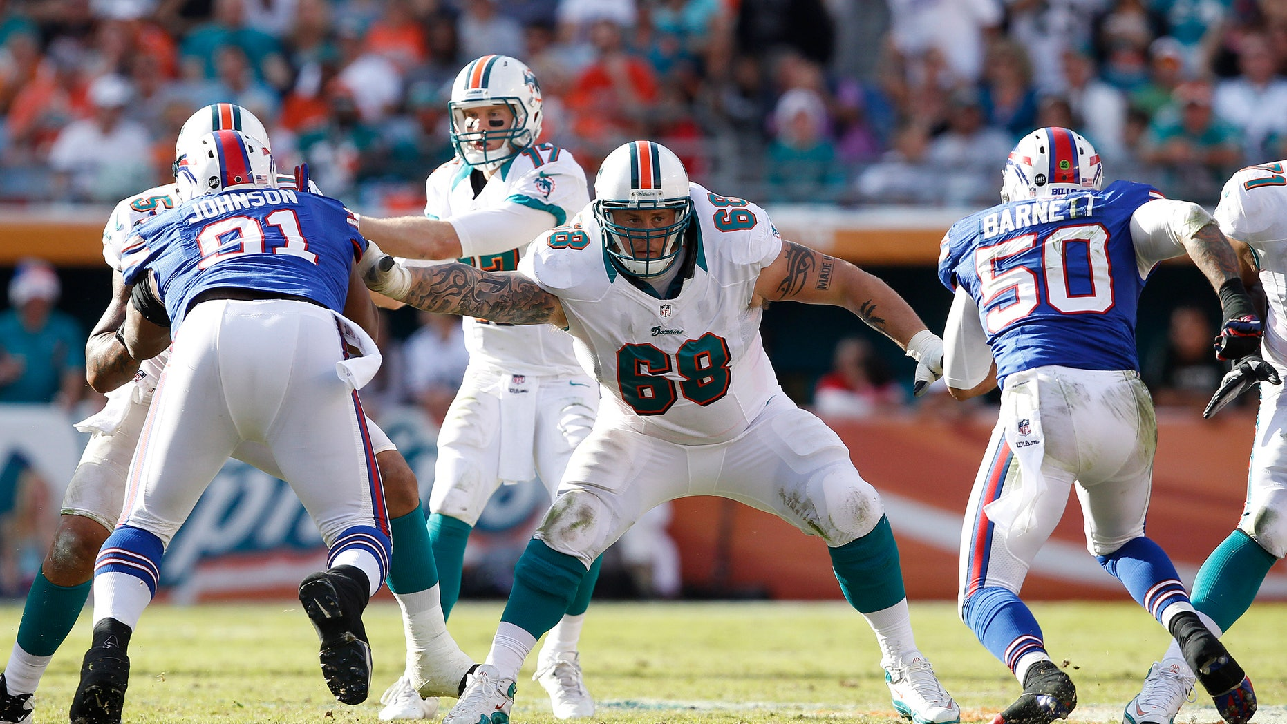 MIAMI GARDENS, FL - DECEMBER 23: Richie Incognito #68 of the Miami Dolphins defends against the Buffalo Bills on December 23, 2012 at Sun Life Stadium in Miami Gardens, Florida. The Dolphins defeated the Bills 24-10. (Photo by Joel Auerbach/Getty Images)
