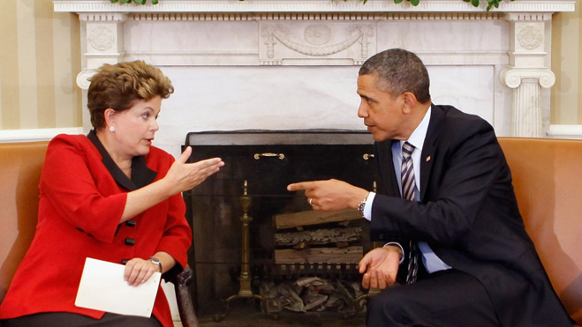 U.S. President Barack Obama and Brazilian President Dilma Rousseff meet in the Oval Office on April 9, 2012.