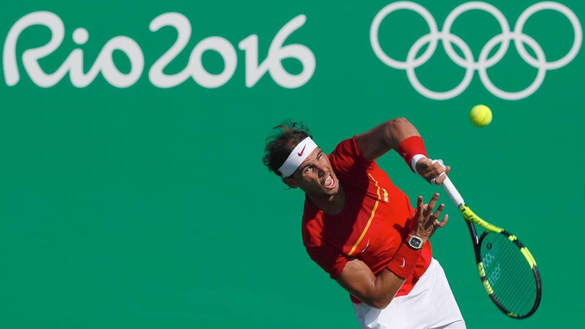 Spain's Rafael Nadal serves to Japan's Kei Nishikori during the bronze medal match of the men's tennis competition at the 2016 Summer Olympics in Rio de Janeiro, Brazil, Sunday, Aug. 14, 2016. (AP Photo/Vadim Ghirda)