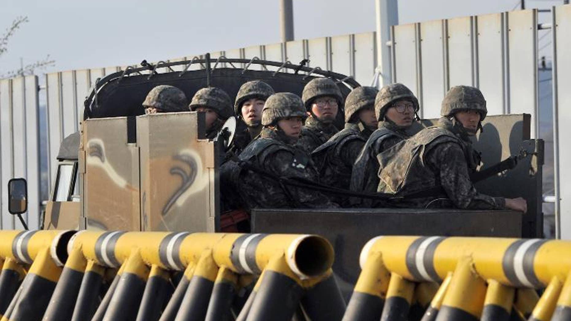 South Korean soldiers ride a military vehicle on the road leading to North Korea in the border city of Paju on April 26, 2013.
