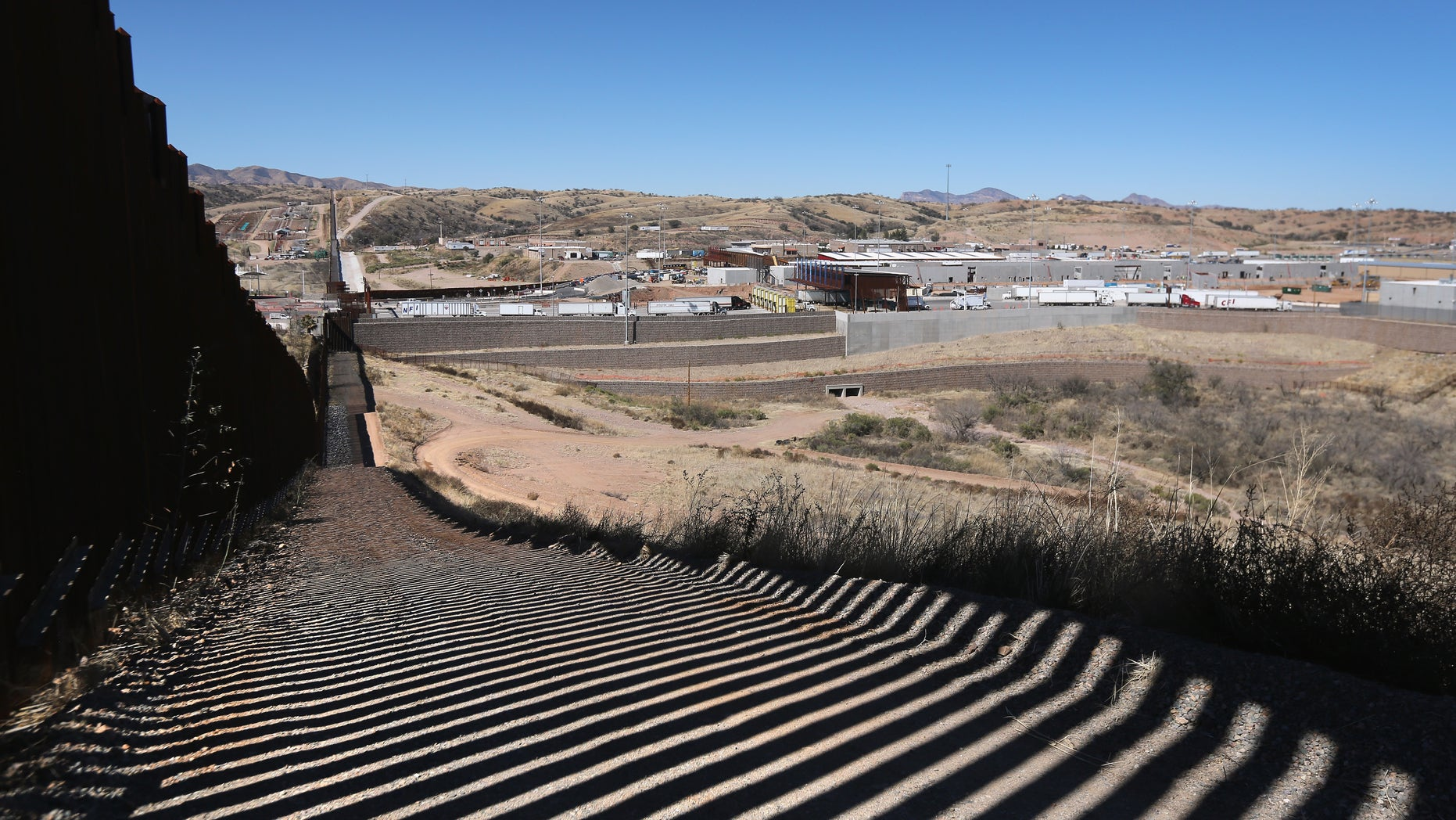 The U.S.-Mexico border stretches into the distance in Nogales, Arizona.