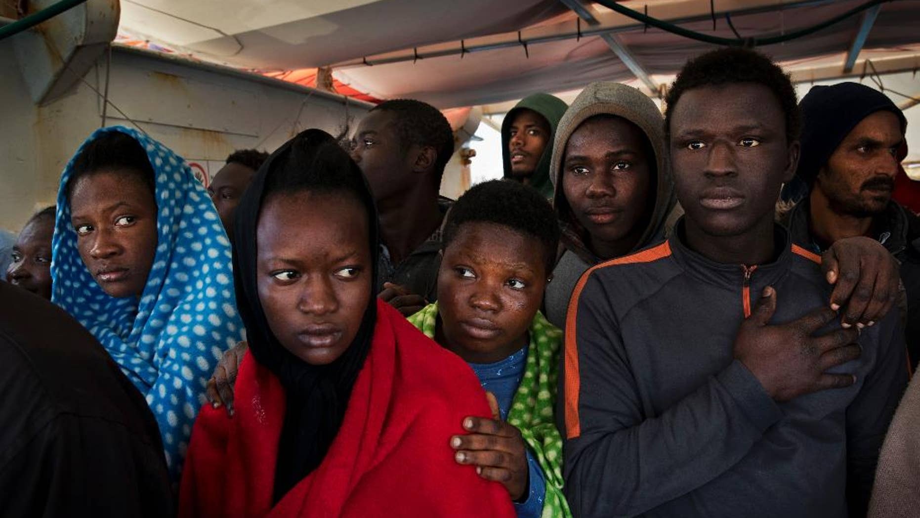 FILE - In this April 8, 2017 file photo, migrants aboard the Golfo Azurro rescue vessel wait to be transferred to Italian authorities in Trapani harbor, in the Italian island of Sicily. Most, though, don't understand that this could be just one more step in an impossible dream. Many are sent to government-run migrant camps. Others, depending on international agreements, are sent back home. (AP Photo/Bernat Armangue, File)