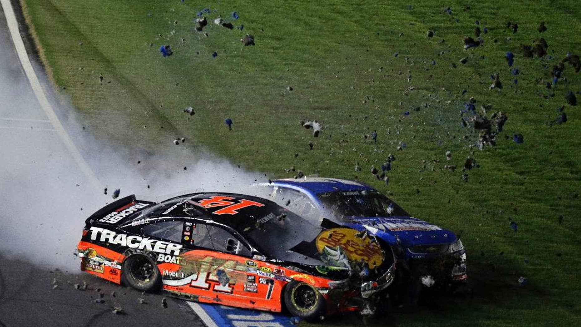 Tony Stewart (14) collides with Kasey Kahne on the front stretch during the NASCAR Sprint All-Star auto race at Charlotte Motor Speedway in Concord, N.C., Saturday, May 21, 2016. (AP Photo/Gerry Broome)