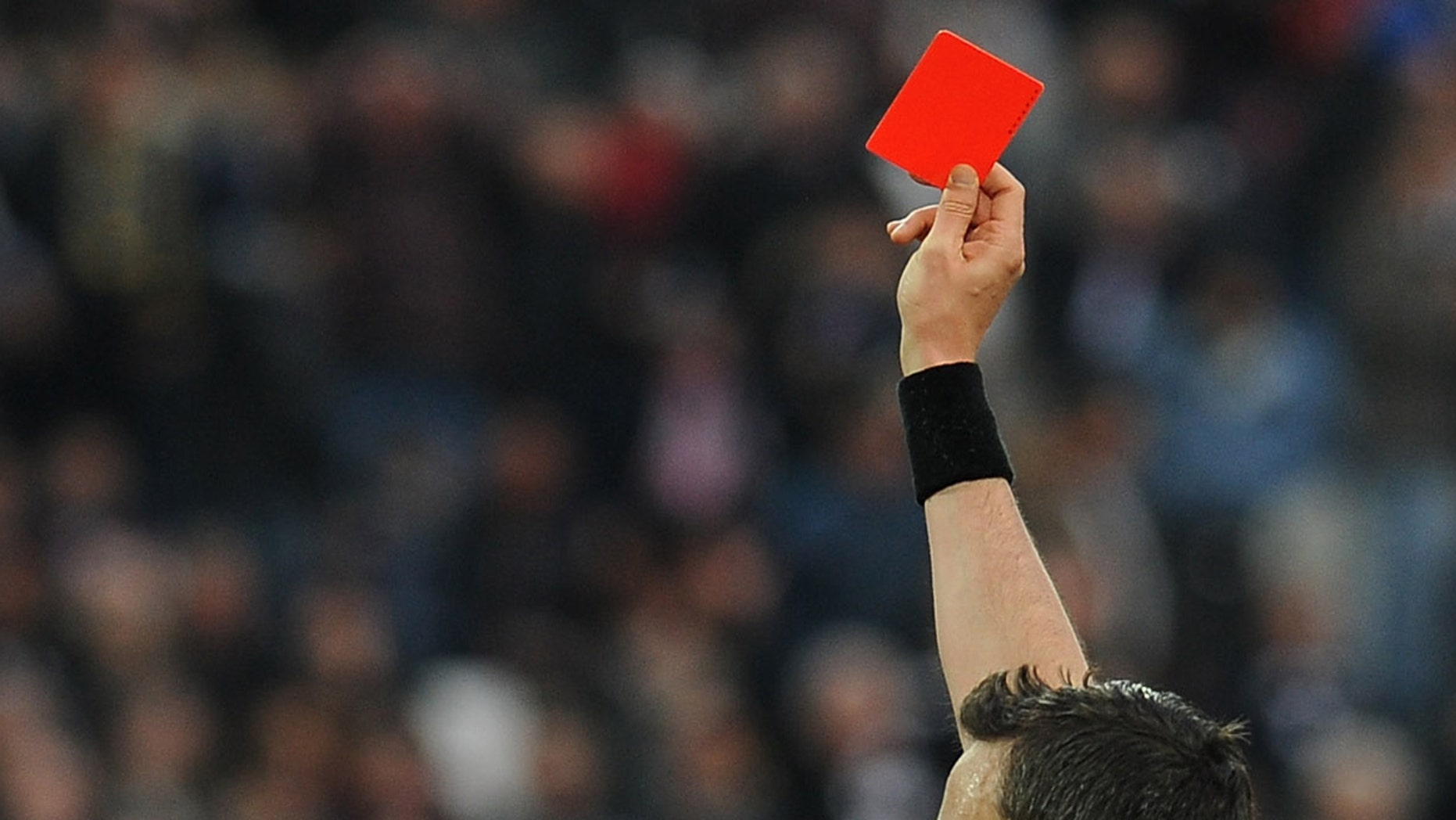 TURIN, ITALY - APRIL 06:  Giuseppe Rizzo (C) of Pescara receives the red card from referee Sebastiano Peruzzo during the Serie A match between Juventus and Pescara at Juventus Arena on April 6, 2013 in Turin, Italy.  (Photo by Valerio Pennicino/Getty Images)