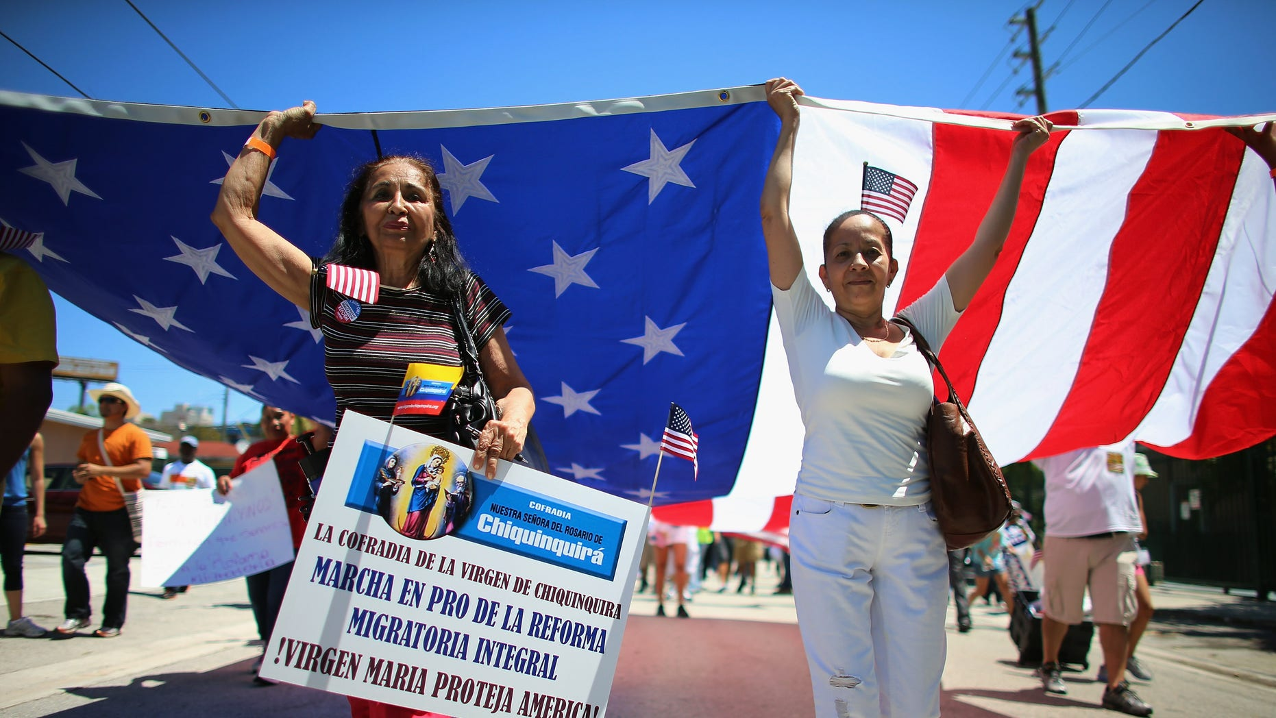 MIAMI, FL - APRIL 06:  People participate in a protest march that organizers said was an attempt to get the U.S. Congress to say yes to immigration reform on April 6, 2013 in Miami, Florida. The marchers were calling for a new immigration system with a real and inclusive path to citizenship for 11 million aspiring Americans, and to keep families together.  (Photo by Joe Raedle/Getty Images)