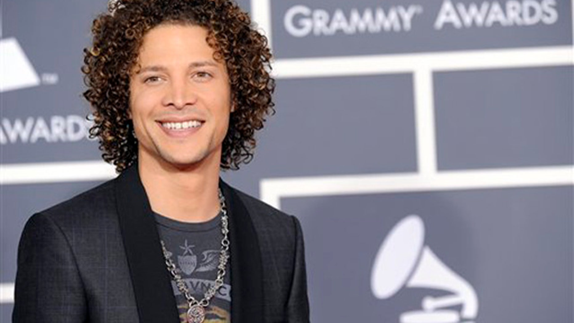 Justin Guarini arrives at the Grammy Awards on Sunday, Jan. 31, 2010, in Los Angeles. (AP Photo/Chris Pizzello)