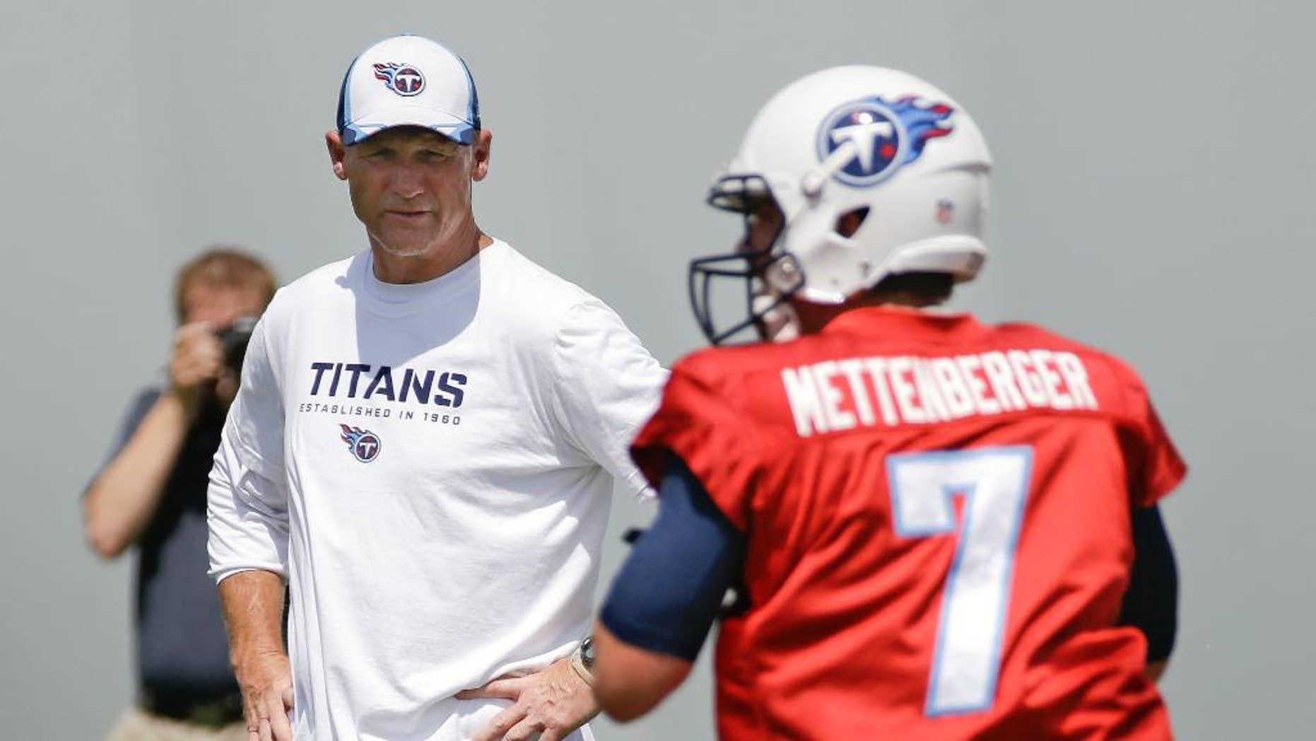 Tennessee Titans head coach Ken Whisenhunt watches as quarterback Zach Mettenberger (7) throws during NFL football minicamp on Tuesday, June 17, 2014, in Nashville, Tenn. (AP Photo/Mark Humphrey)