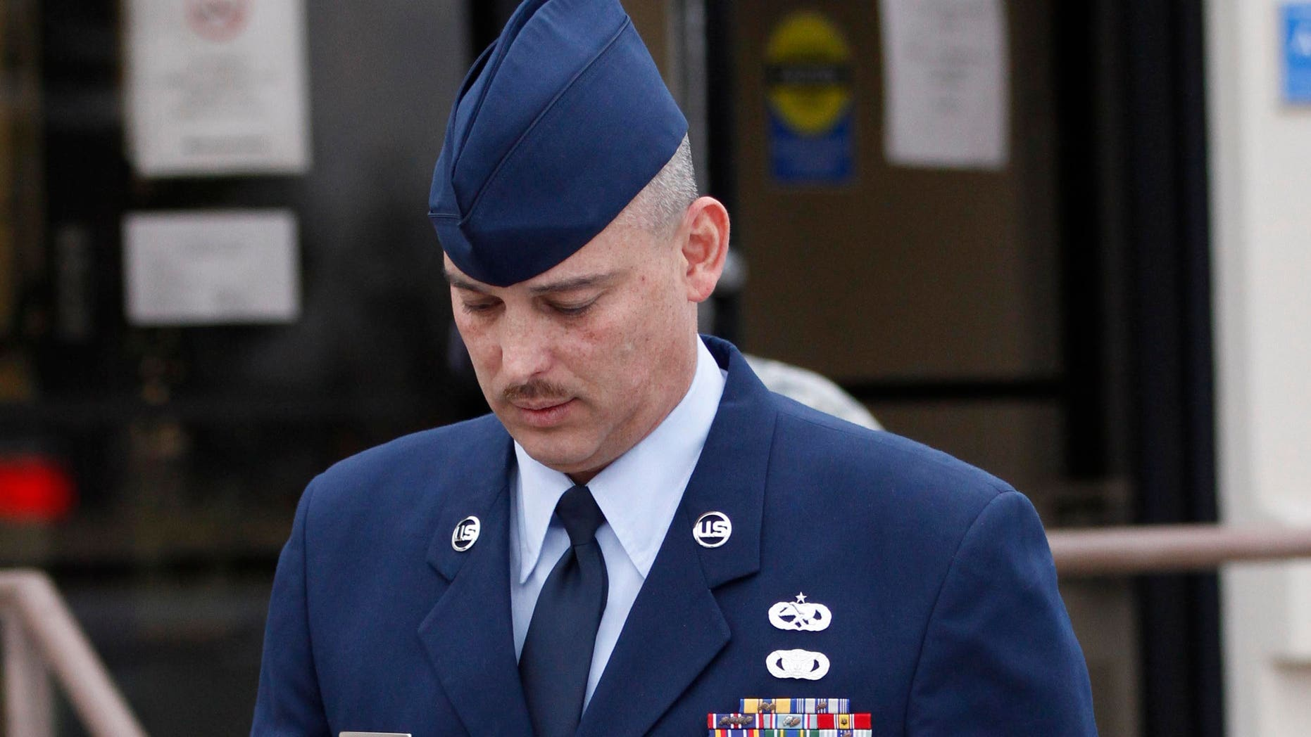 Air Force Sgt. David Gutierrez, right, walks out of the Law Center at McConnell Air Force Base in Wichita, Kan., Wednesday, Jan. 19, 2011 for a lunch recess. The defense rested Wednesday for Gutierrez, who is HIV positive and is accused of exposing multiple sex partners to HIV at swinger parties. (AP Photo/Jeff Tuttle)