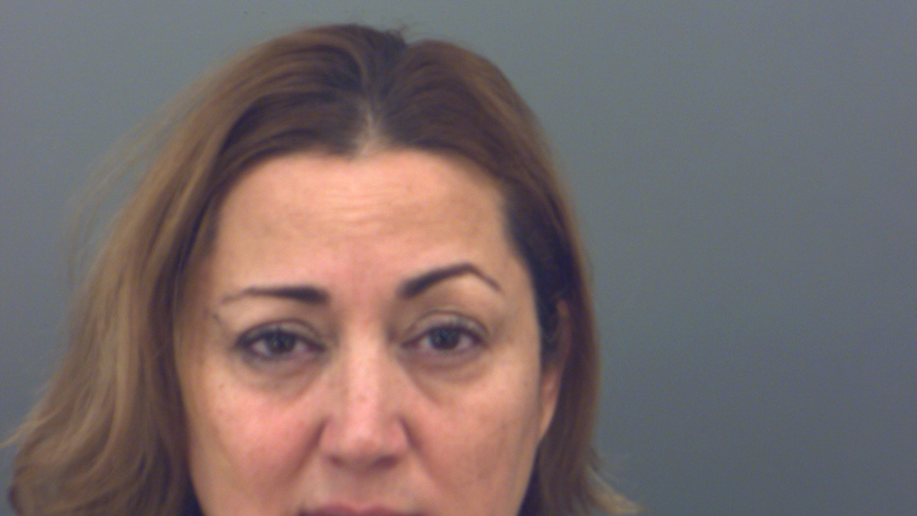 Olga Najera was arrested Monday, accused of slapping a student.