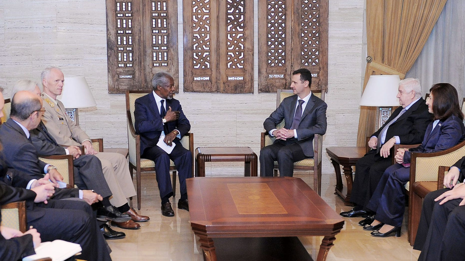 May 29, 2012: In this photo released by the Syrian official news agency SANA shows UN-Arab League Joint Special Envoy for Syria (JSE) Kofi Annan, fourth left, Norwegian Maj. Gen. Robert Mood, head of the U.N. observer team in Syria, third left, Syrian President Bashar Assad, third right, and Syrian Foreign Minister Walid Moallem, second right, attend a meeting in Damascus, Syria. International envoy Kofi Annan met Syrian President Bashar Assad on Tuesday following a massacre last week that killed more than 100 people and sparked widespread international condemnation against Damascus.