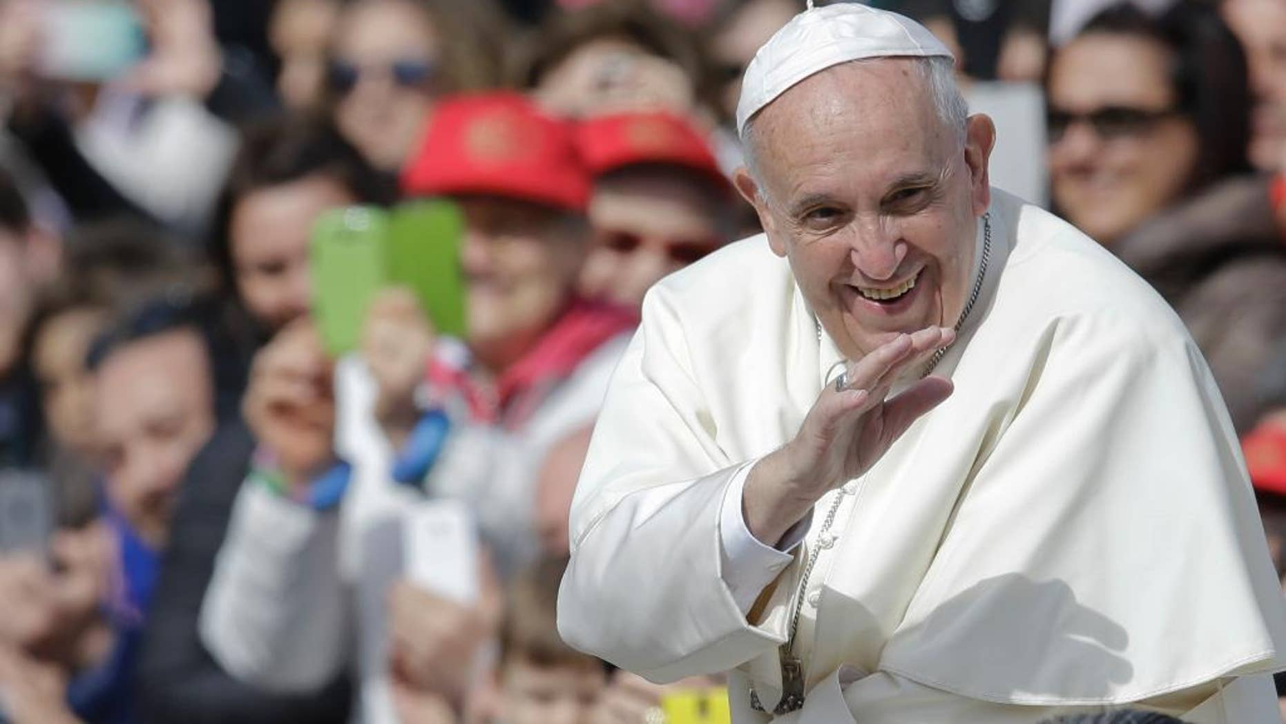 Pope Francis smiles as he blesses faithful upon his arrival in St. Peter's Square to attend a jubilee audience at the Vatican, Saturday, April 9, 2016. Pope Francis said Friday that Catholics should look to their own consciences rather than rely exclusively on church rules to negotiate the complexities of sex, marriage and family life, demanding the church shift emphasis from doctrine to mercy in confronting some of the thorniest issues facing the faithful. (AP Photo/Gregorio Borgia)