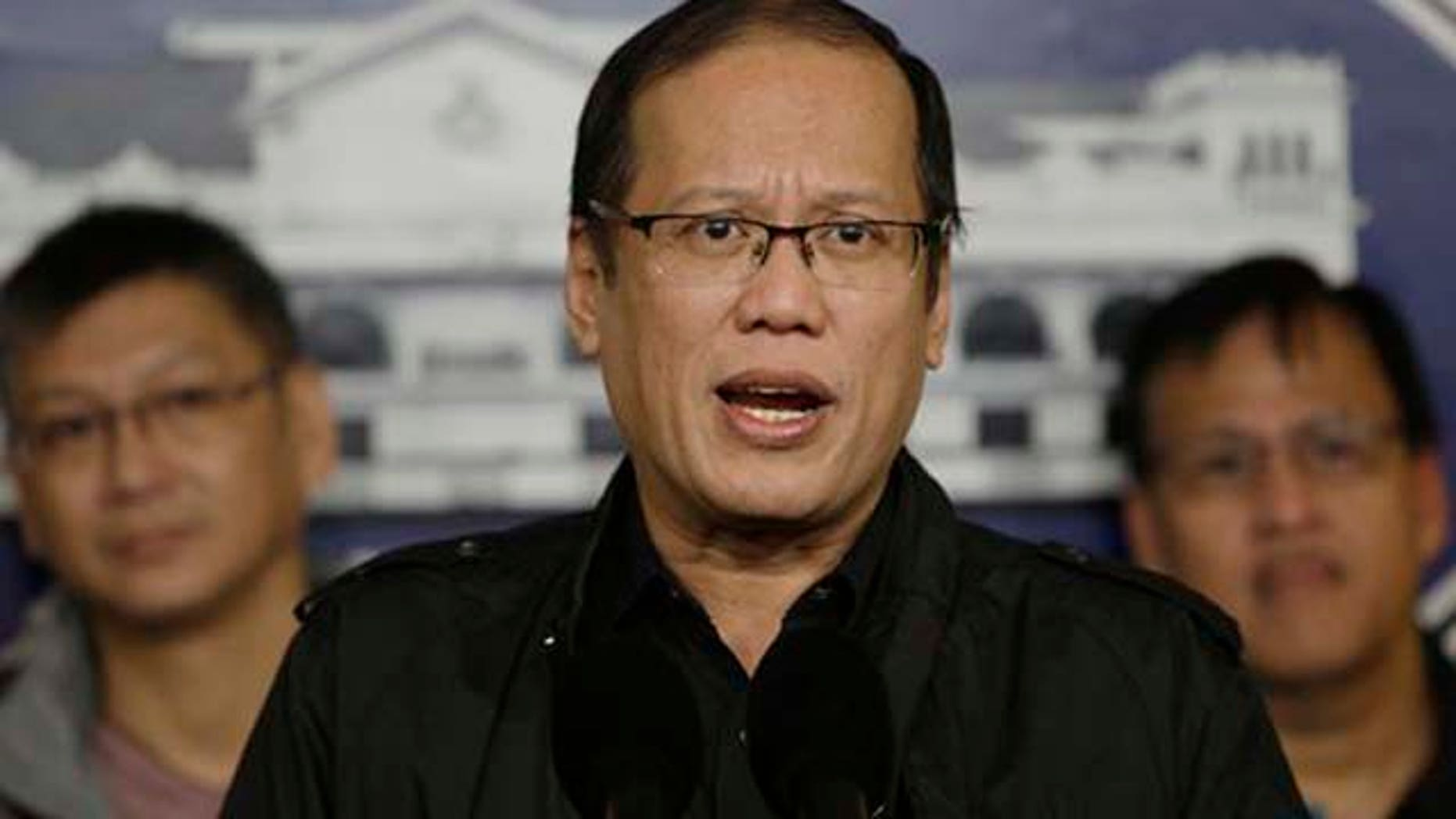 January 8, 2012: Philippine President Benigno Aquino III, center, talks during a hastily called press conference at the Malacanang palace in Manila, Philippines.
