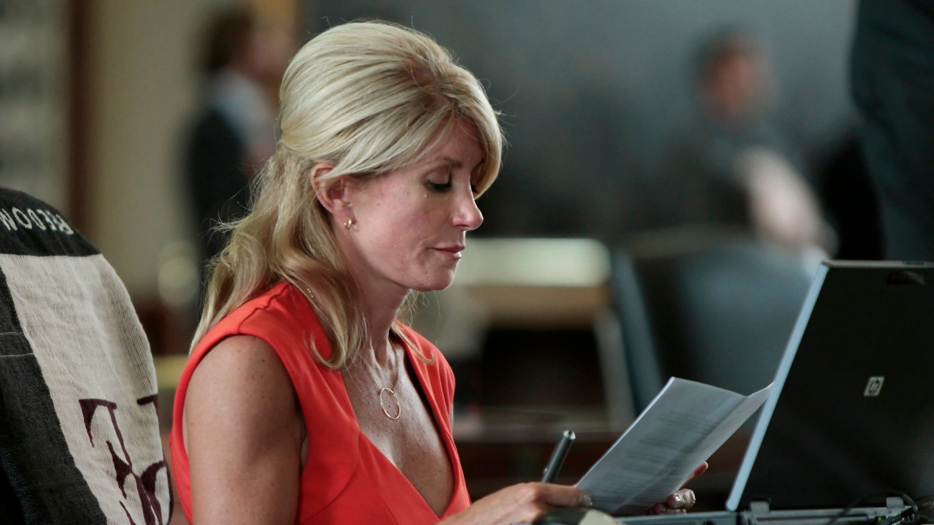 Texas Sen. Wendy Davis sits at her desk. Erich Schlegel/Getty Images.