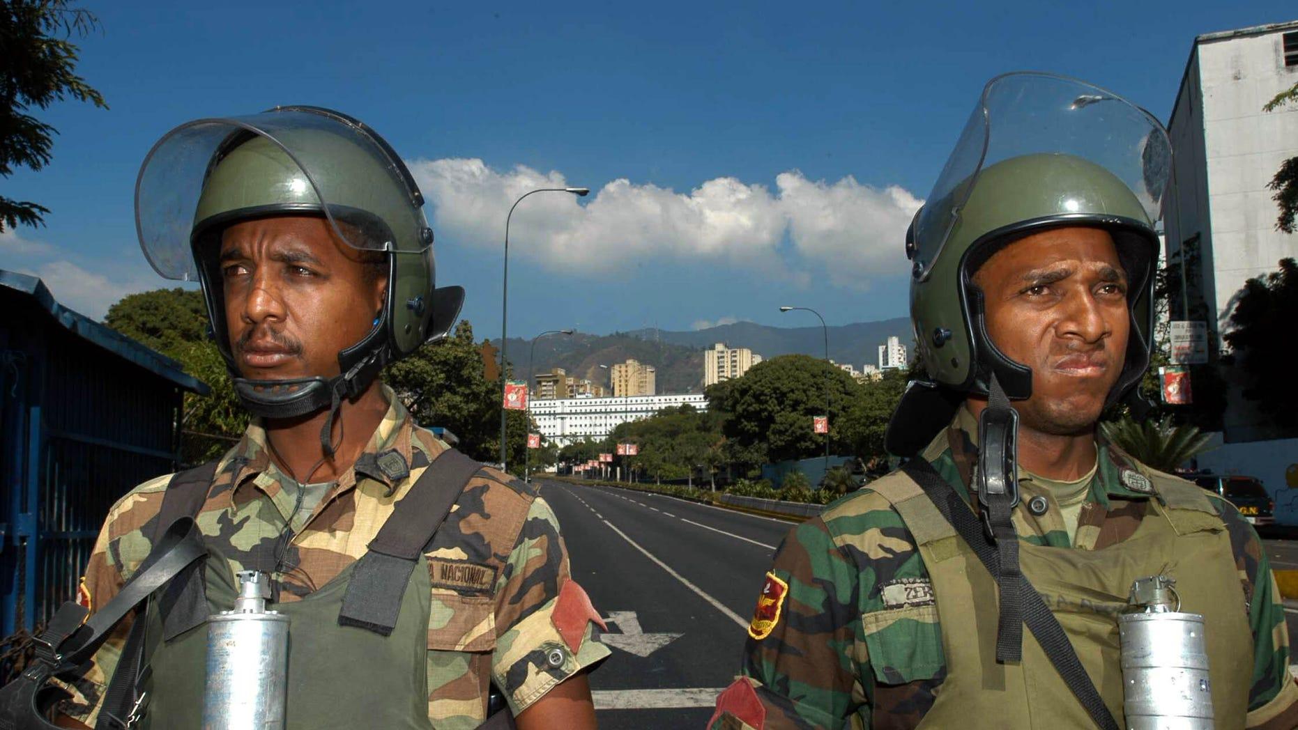 Members of the National Guard near the Miraflores Palace in Caracas, Venezuela.