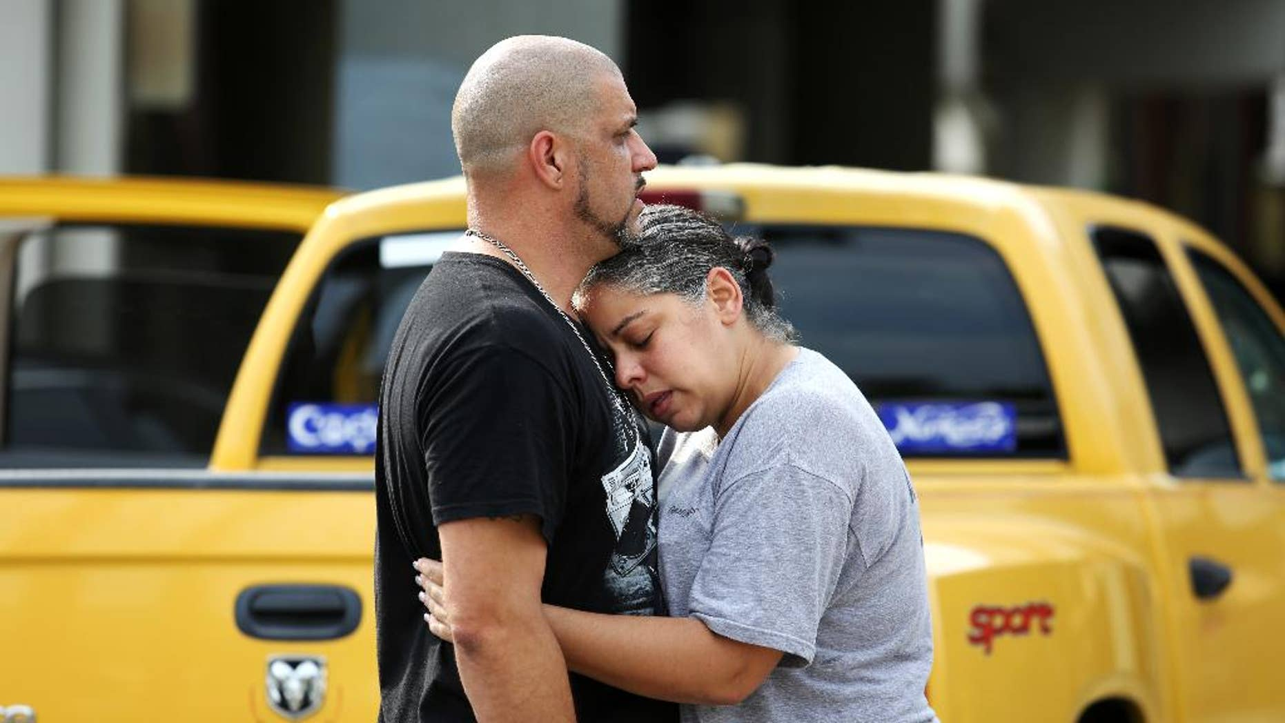 Ray Rivera, left, a DJ at Pulse Orlando nightclub, is consoled by a friend, outside of the Orlando Police Department after a shooting involving multiple fatalities at the nightclub, Sunday, June 12, 2016, in Orlando, Fla. (Joe Burbank/Orlando Sentinel via AP) MAGS OUT; NO SALES; MANDATORY CREDIT