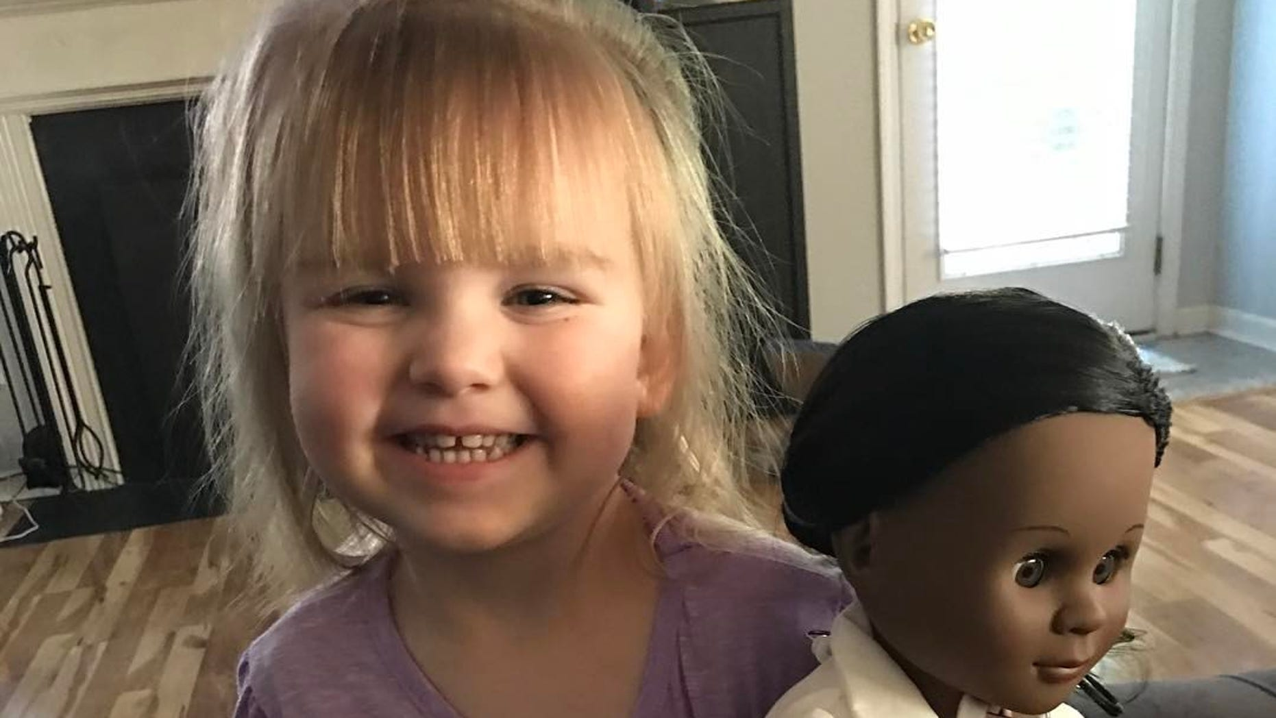 Sophia showing off her doll.