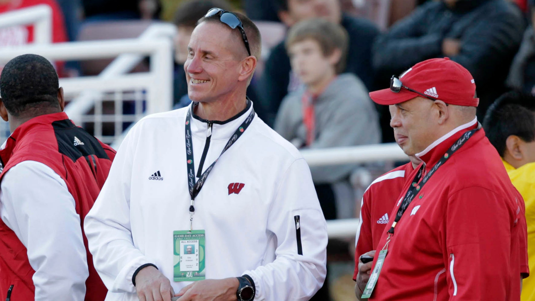 In this photo taken Jan. 1, 2013, the Wisconsin new  football coach Gary Andersen, center, watches from the sidelines with deputy athletic director Sean Frazier during the Rose Bowl football game between the Stanford Cardinals and Wisconsin in Pasadena, Calif. Andersen came into the spring with plenty of starters returning for the three-time defending Big Ten champion Badgers. But Montee Ball is gone, and an Ohio State team that went 12-0 last season is eligible again. (AP Photo/The Wisconsin State Journal, Michael P. King)