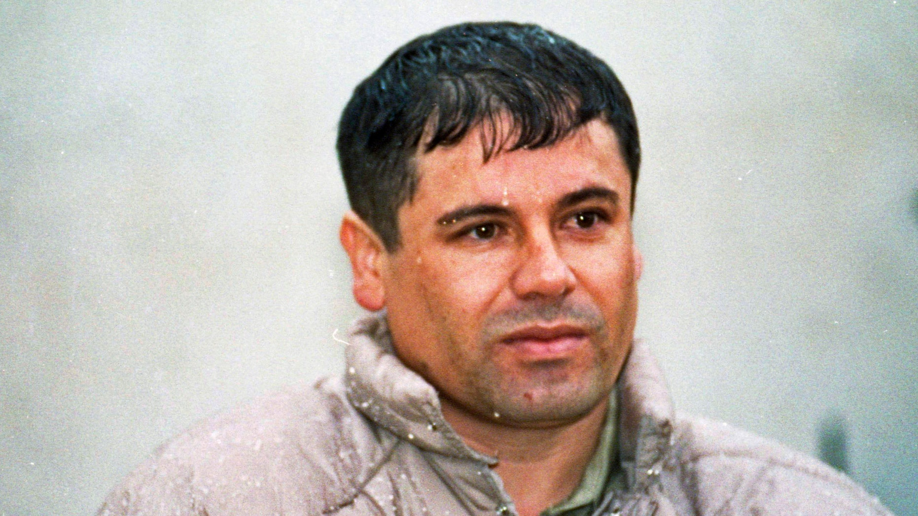 """In this June 10, 1993 file photo, Joaquin Guzman Loera, alias """"El Chapo"""" Guzman, is shown to the media after his arrest at the high security prison of Almoloya de Juarez, on the outskirts of Mexico City. (AP Photo/Damian Dovarganes, File)"""