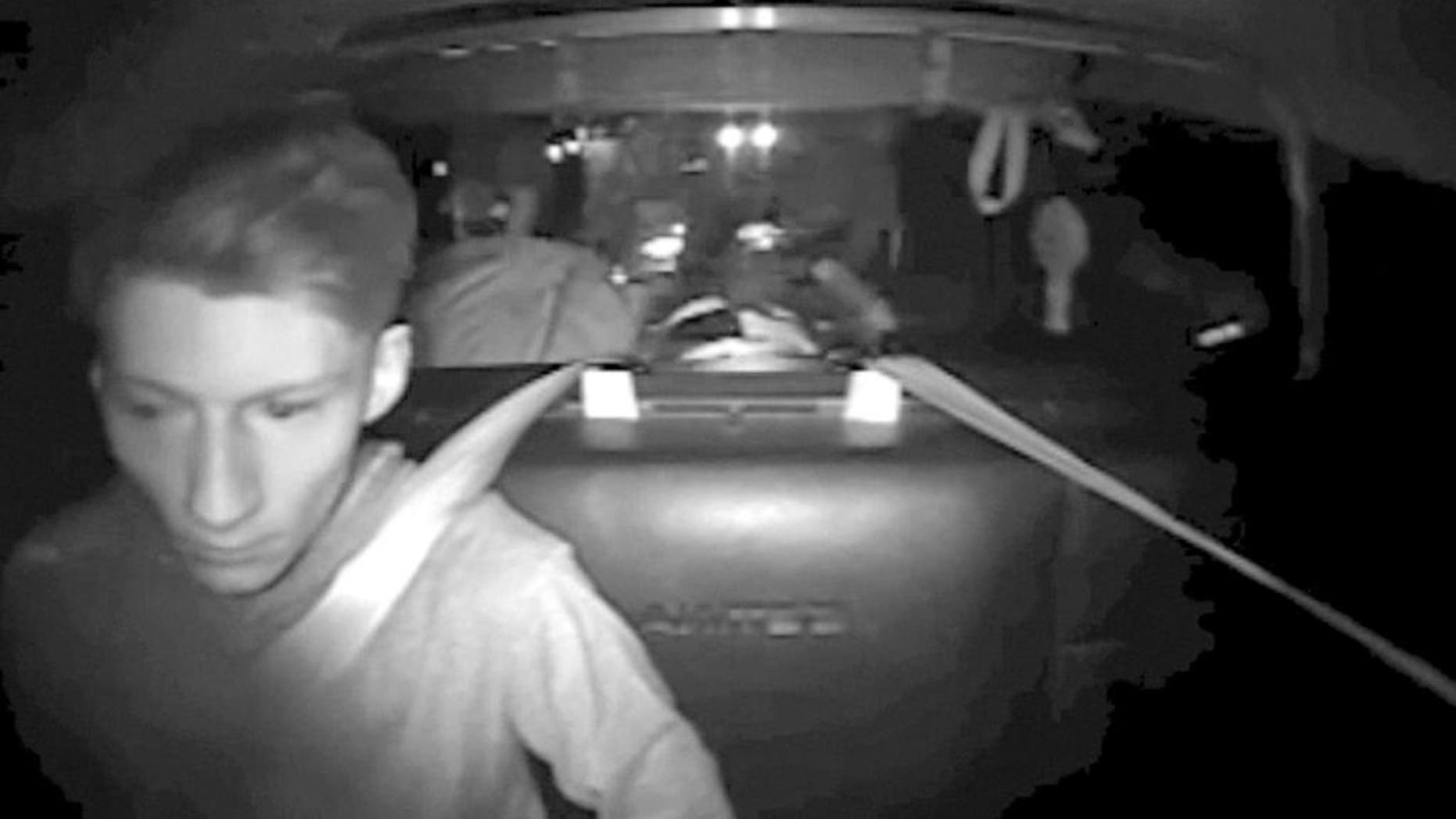 """This July 30, 2016, image made from a video provided by Washington State Patrol via The Daily Herald shows Allen Ivanov in the back of a patrol car in a police camera video shortly after his arrest on Interstate 5 in Lewis County, Wash. Court documents say Ivanov, a 19-year-old man accused of fatally shooting three teenagers at a house party in Mukilteo last month, sent his friends text messages alluding to his plans, including one in which he wrote: """"I'm killing everyone at a huge party."""" (Washington State Patrol via The Daily Herald via AP)"""