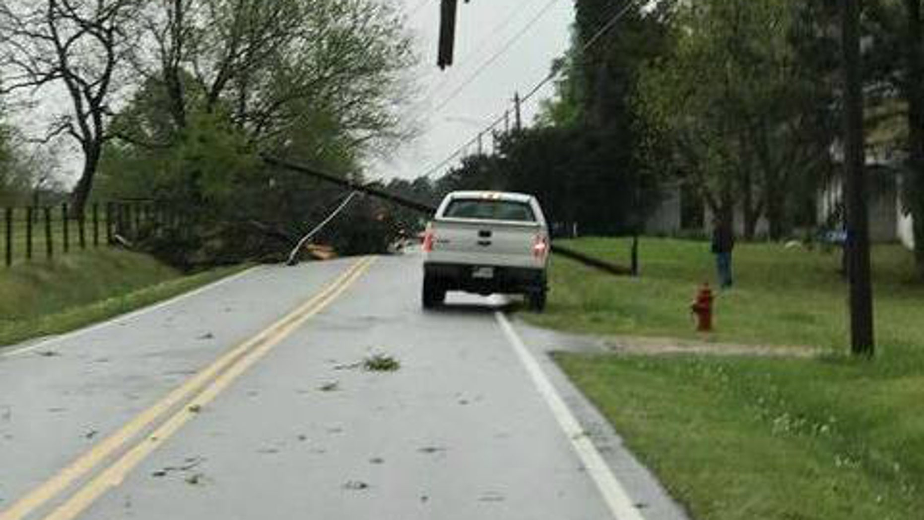 A cross from a fallen power pole makes an appearance in Georgia after severe weather pounds the area.