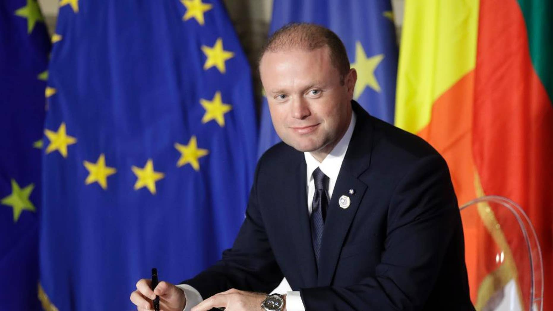 FILE - In this Saturday, March 25, 2017 file photo, Malta's Prime Minister Joseph Muscat signs a declaration during an EU summit meeting in the Palazzo dei Conservatori in Rome. Malta's Prime Minister Joseph Muscat has called elections for June 3, a year early, to test his popularity amid a scandal swirling around his family. With the announcement on Monday, May 1, Muscat defied opposition demands for his resignation. (AP Photo/Alessandra Tarantino, file)