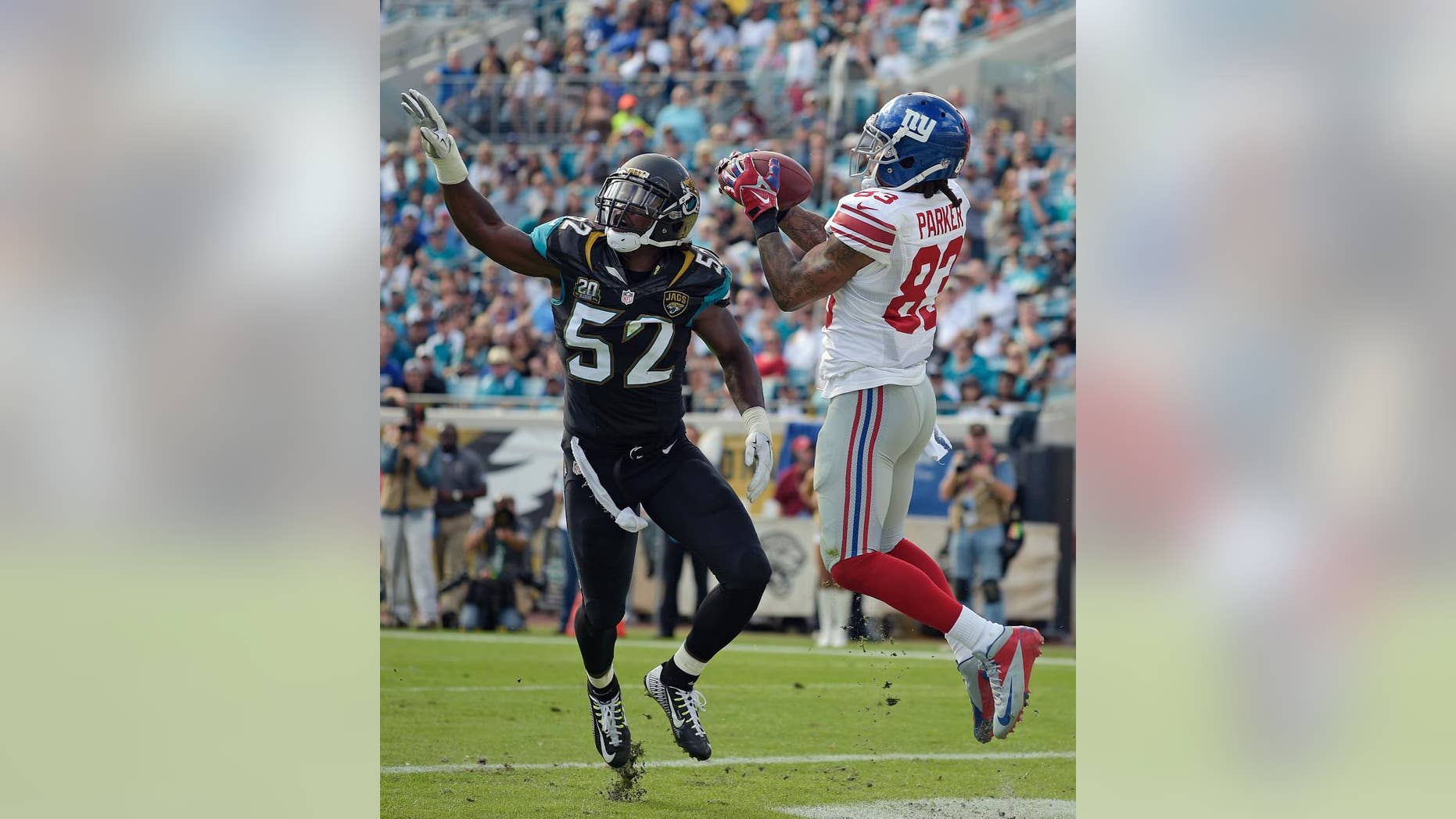 New York Giants wide receiver Preston Parker (83) catches a 3-yard touchdown pass in front of Jacksonville Jaguars outside linebacker J.T. Thomas (52) during the first half of an NFL football game in Jacksonville, Fla., Sunday, Nov. 30, 2014. (AP Photo/Phelan M. Ebenhack)