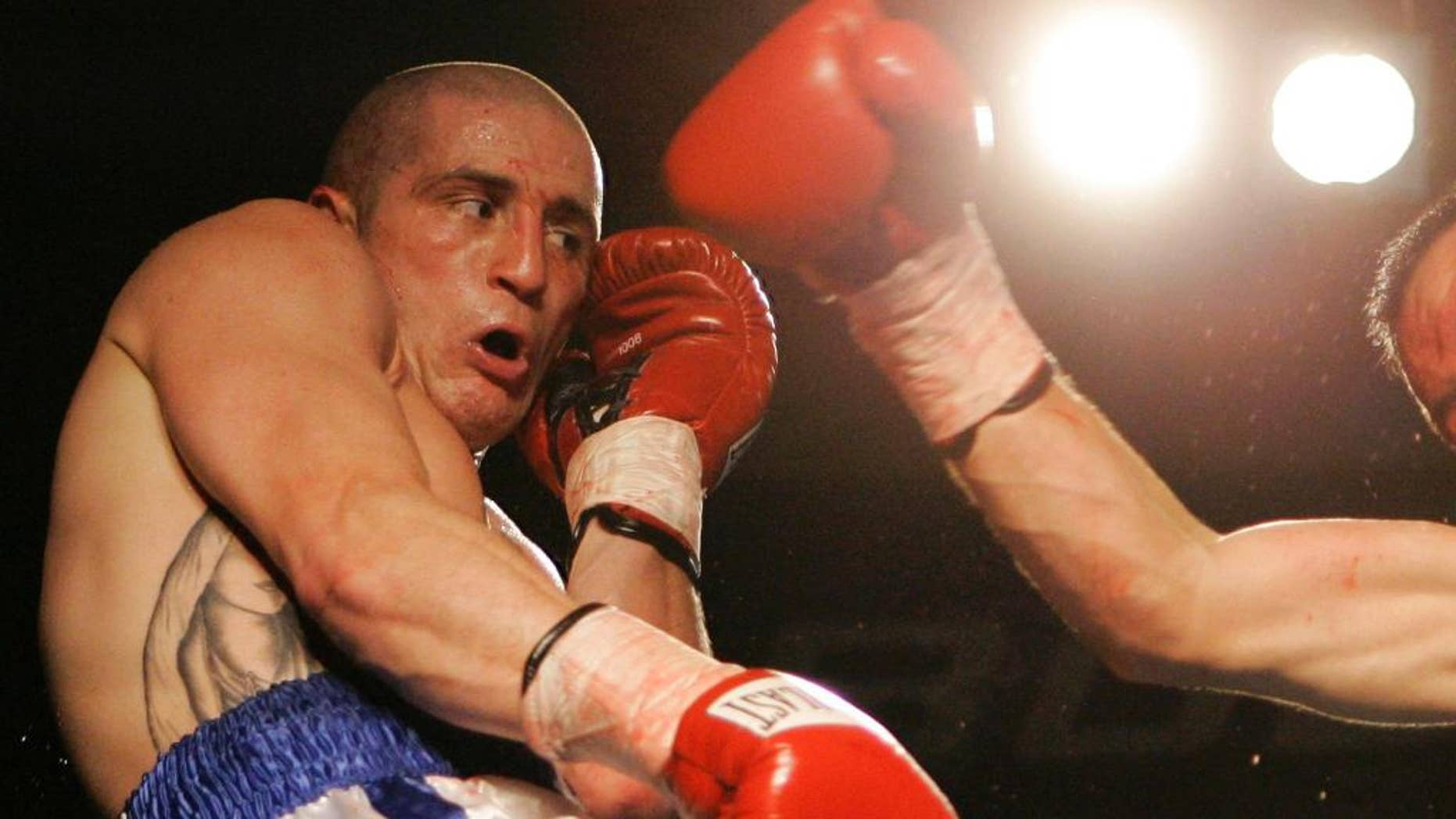 FILE - In this Nov. 22, 2006, file photo, Jesus Francisco Zepeda, of Mexico, misses with a right to Paul Spadafora, left, during their boxing bout in Erie, Pa. Spadafora is in jail again, this time for allegedly stabbing his brother Wednesday, Dec. 21, 2016, during an argument and then fighting with police officers called to intervene, according to a criminal complaint. (AP Photo/Keith Srakocic, File)
