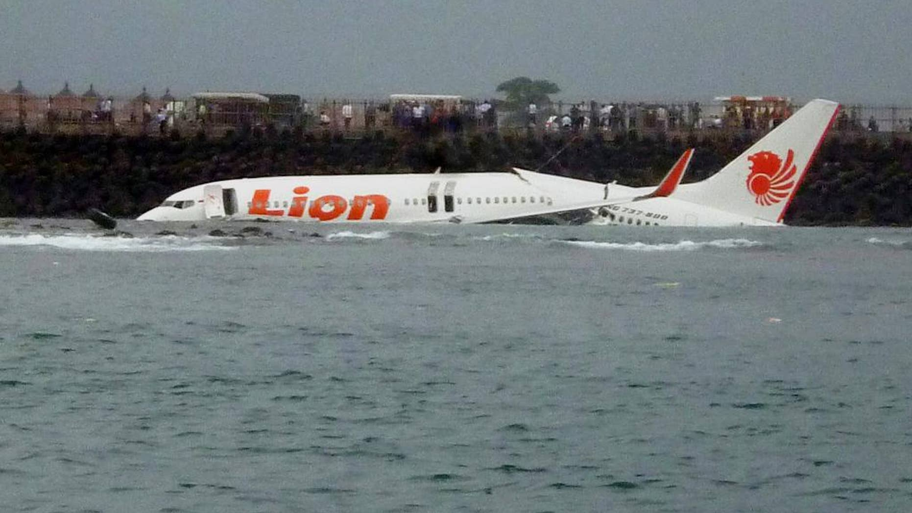 FILE - In this Saturday, April 13, 2013, file photo, the wreckage of a Lion Air plane sits on the water near the airport in Bali, Indonesia. The head of Indonesia's narcotics agency says most of the country's airline accidents have involved pilots on drugs, including a Lion Air jet that slammed into the sea four years ago while trying to land on Bali. Budi Waseso made the comments Thursday at a ceremony inaugurating Bali's traditional village security guards as anti-drug volunteers. (AP Photo)