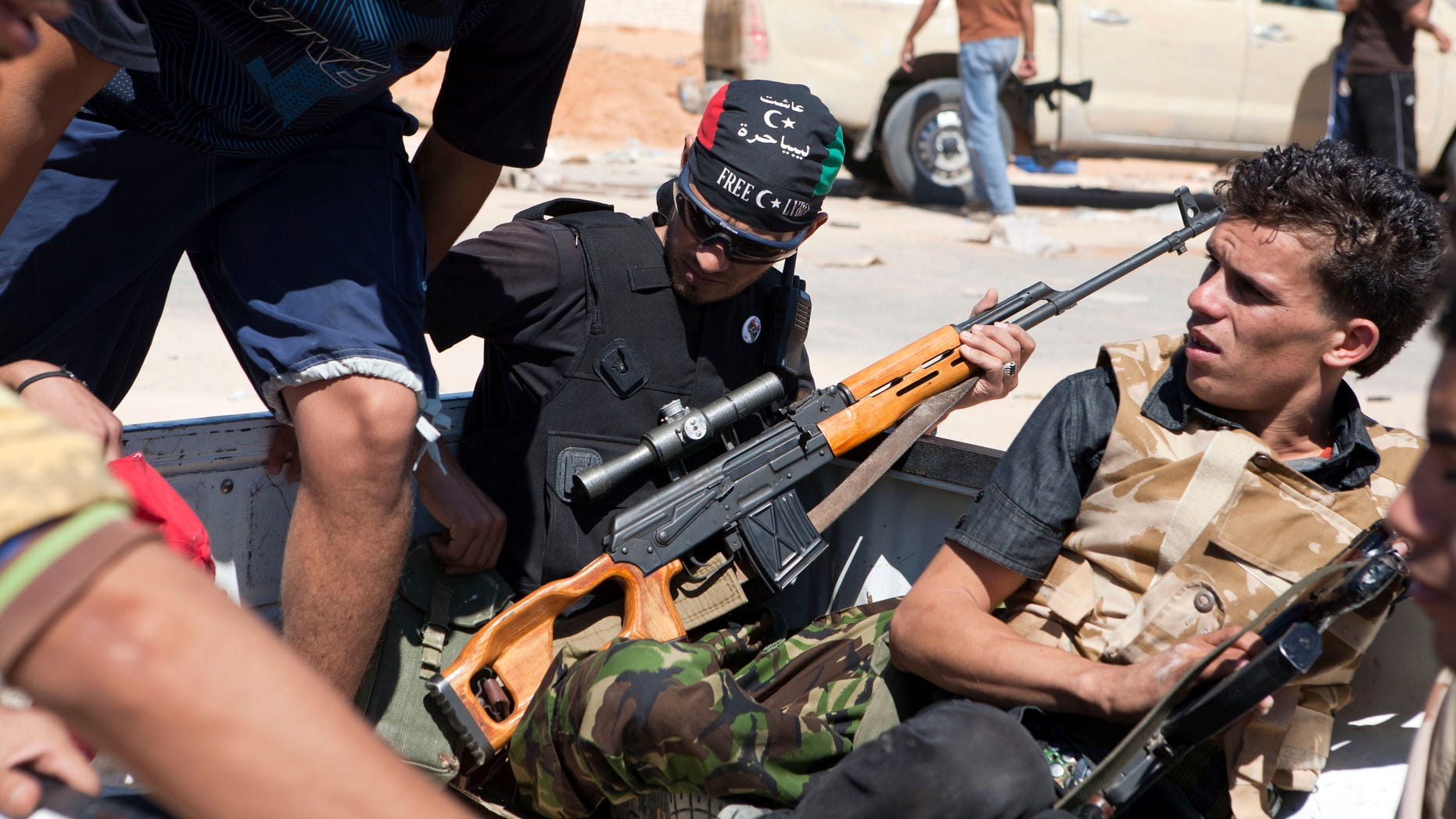 Libyan rebels are seen in the back of a pick-up truck headed for the frontline near Zawiya in western Libya, Saturday, Aug. 13, 2011.