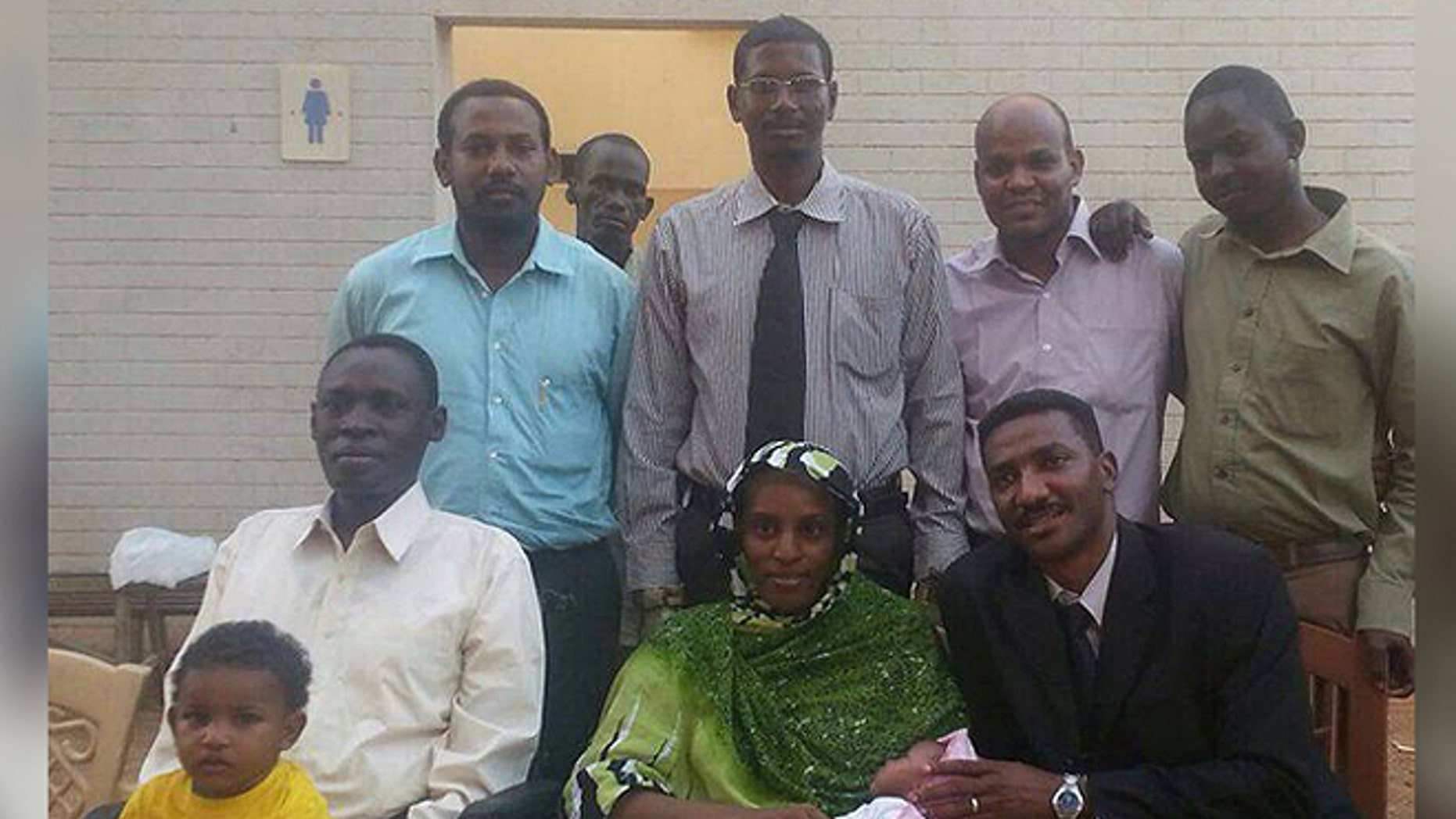 Meriam Ibrahim, with husband Daniel Wani and children Martin and Maya along with their legal team following her release from a Karthoum prison.