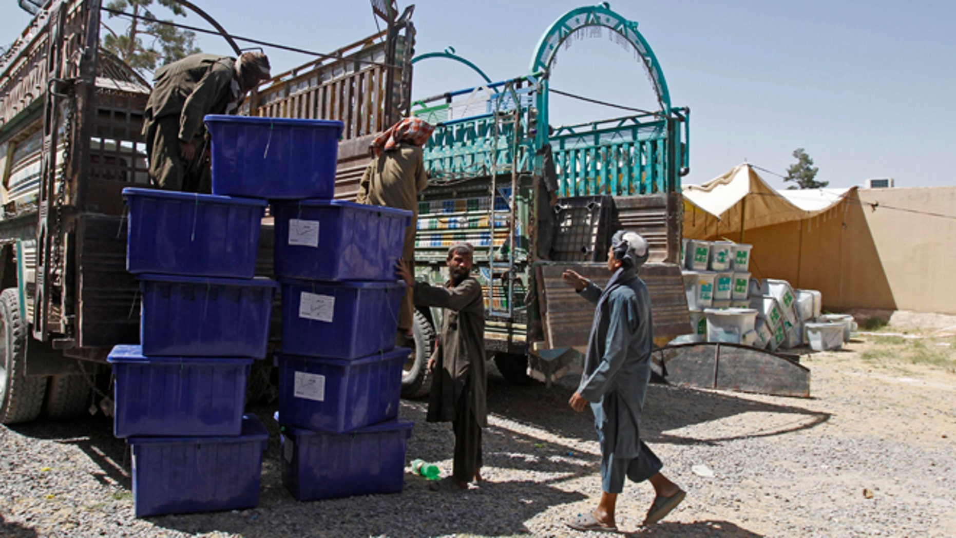 June 12, 2014: Afghan election workers load ballot boxes and election materials into trucks to deliver to polling stations, at a warehouse in Kandahar, Afghanistan. (AP)