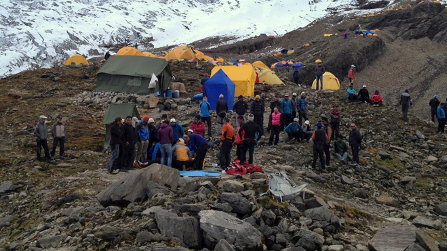 Sept. 23, 2012: In this photo provided by Nepalese airline Simrik Air, rescuers attend to injured victims, unseen, after an avalanche at the base camp of Mount Manaslu in northern Nepal.