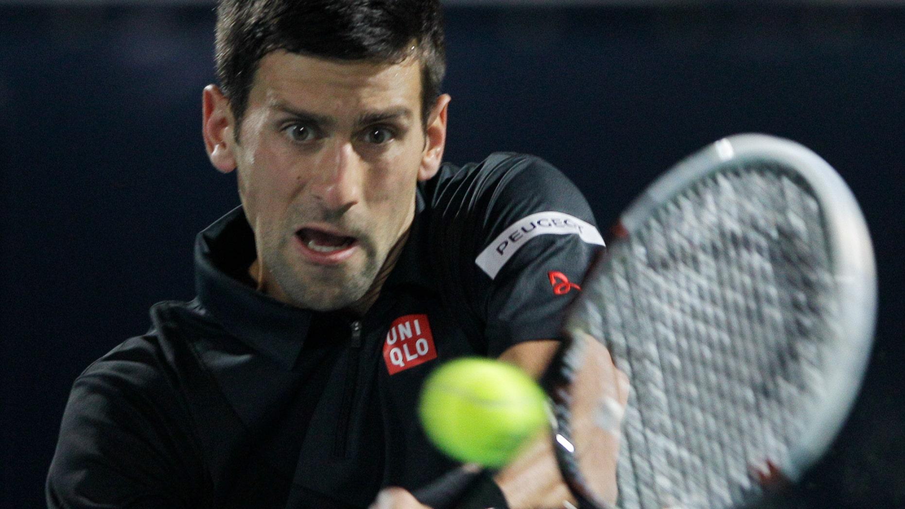 Novak Djokovic of Serbia returns the ball to Spain's Roberto Bautista Agut during the third day of the Dubai Tennis Championships in Dubai, United Arab Emirates, Wednesday, Feb. 26, 2014. (AP Photo/Kamran Jebreili)