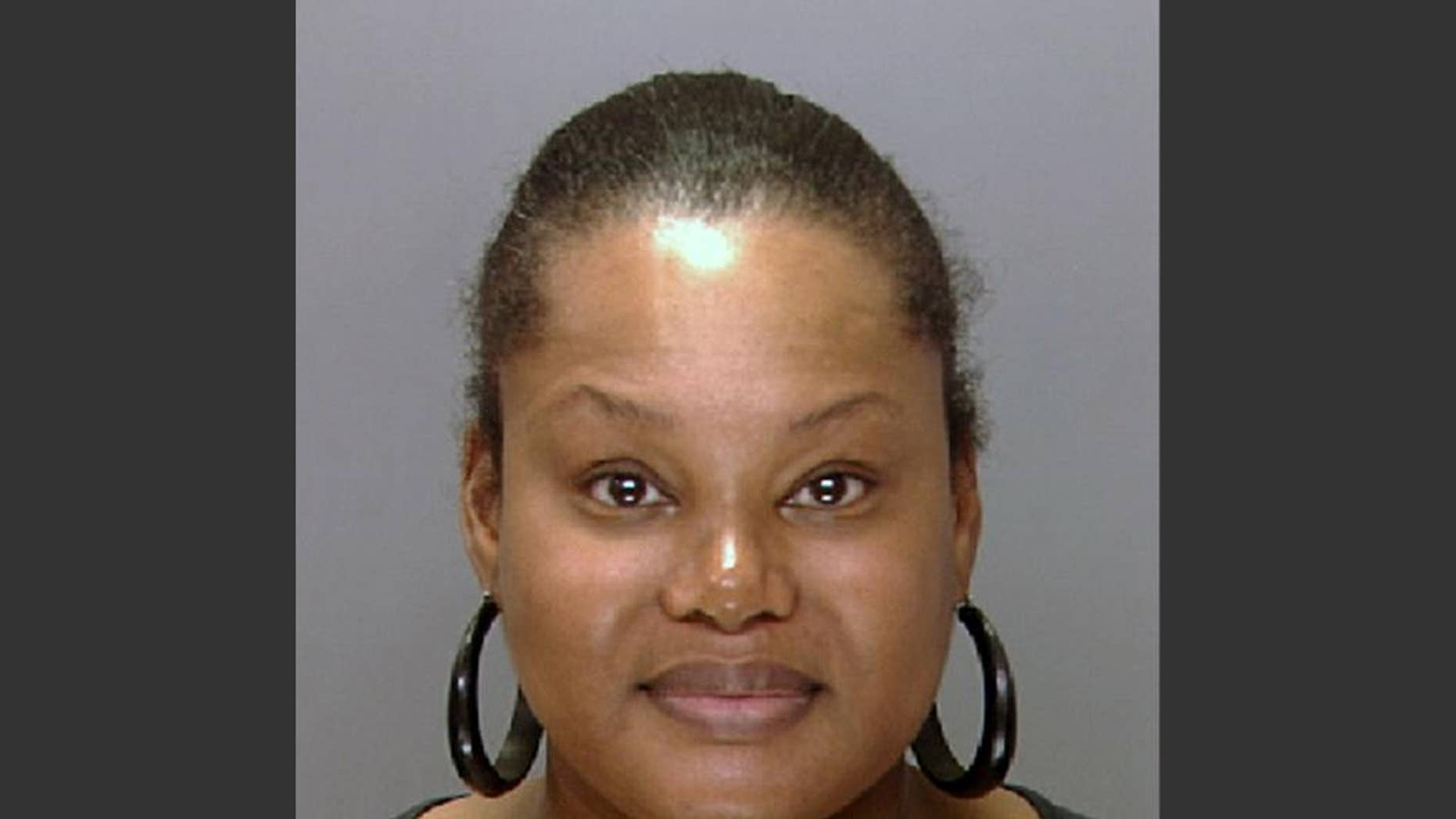 """FILE - This undated file photo provided by the Philadelphia Police Department shows Padge Gordon, also known as Padge Victoria Windslowe. The former madam who bragged of doing black-market """"body sculpting"""" on thousands of women was convicted of murder Monday, March 9, 2015, in the death of a dancer whose heart stopped after nearly half a gallon of silicone was injected into her buttocks. (AP Photo/Philadelphia Police Department, File)"""