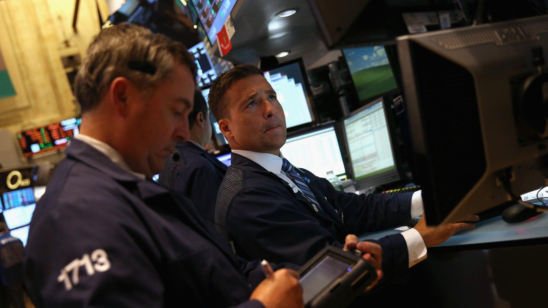Traders work the floor of the New York Stock Exchange on September 16, 2013 in New York City.