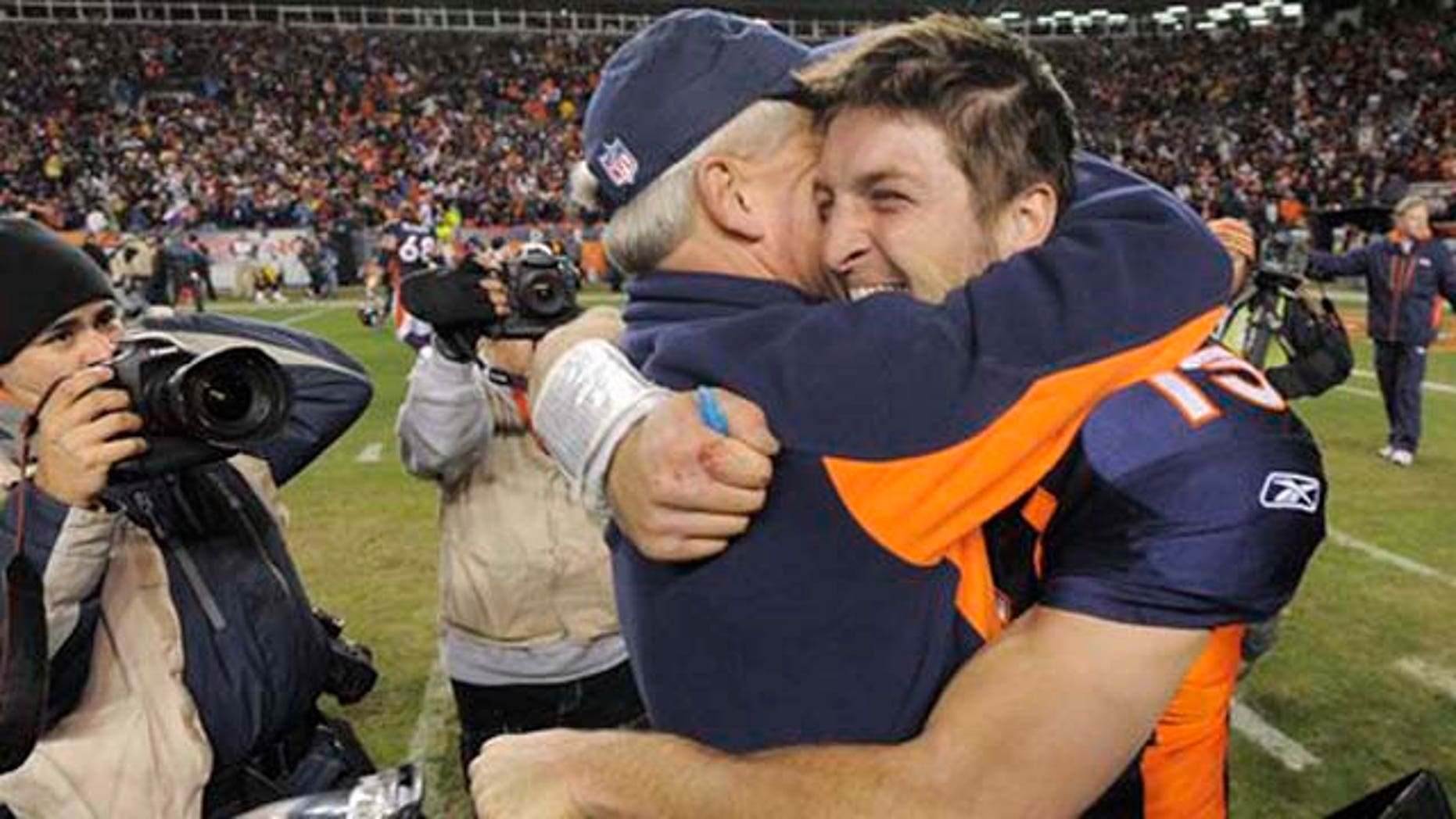 January 8, 2012: Denver Broncos quarterback Tim Tebow (15) hugs coach John Fox after the Broncos defeated the Pittsburgh Steelers 29-23 in overtime in an NFL wild card playoff football game.