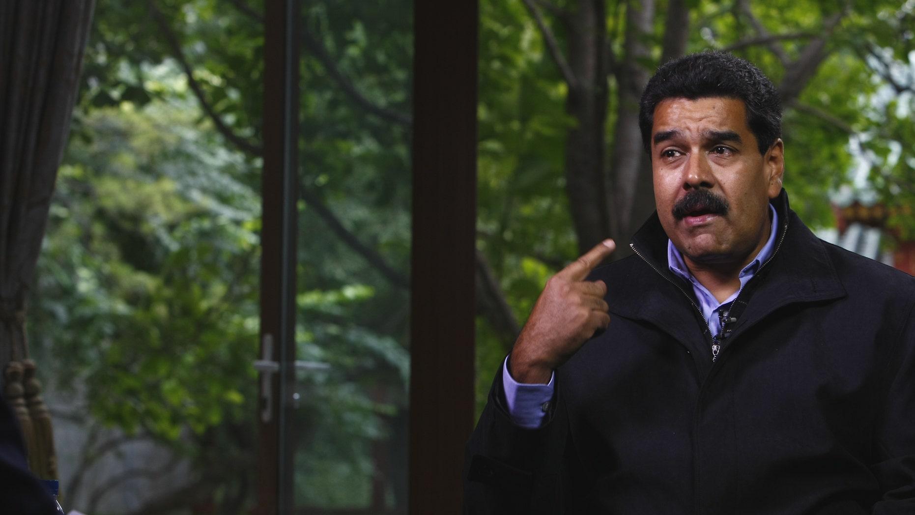 BEIJING, CHINA - SEPTEMBER 23:  (CHINA OUT) Venezuelan President Nicolas Maduro Moros is interviewed by Chinatoday, Chinadaily and CCTV at Diaoyutai State Guesthouse on September 23, 2013 in Beijing, China.  (Photo by ChinaFotoPress/Getty Images)