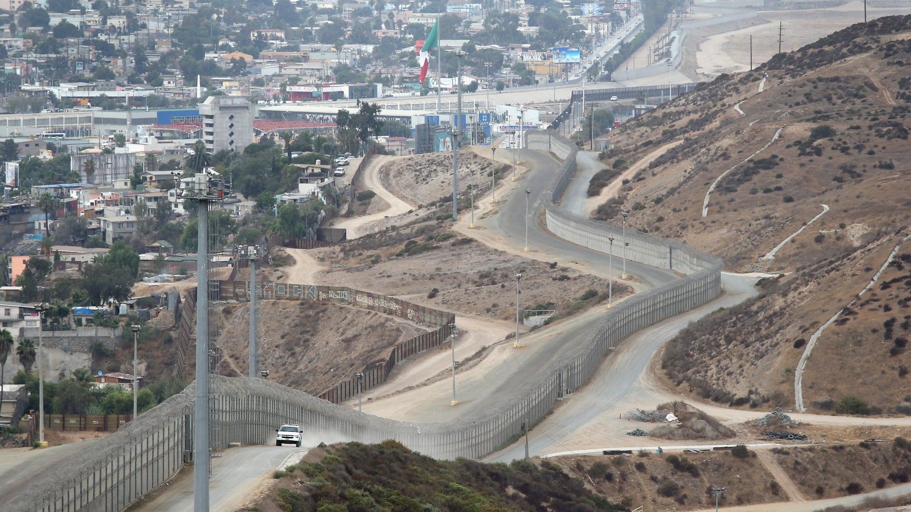 A stretch of the U.S.-Mexico border fence on October 3, 2013 near San Ysidro, California.