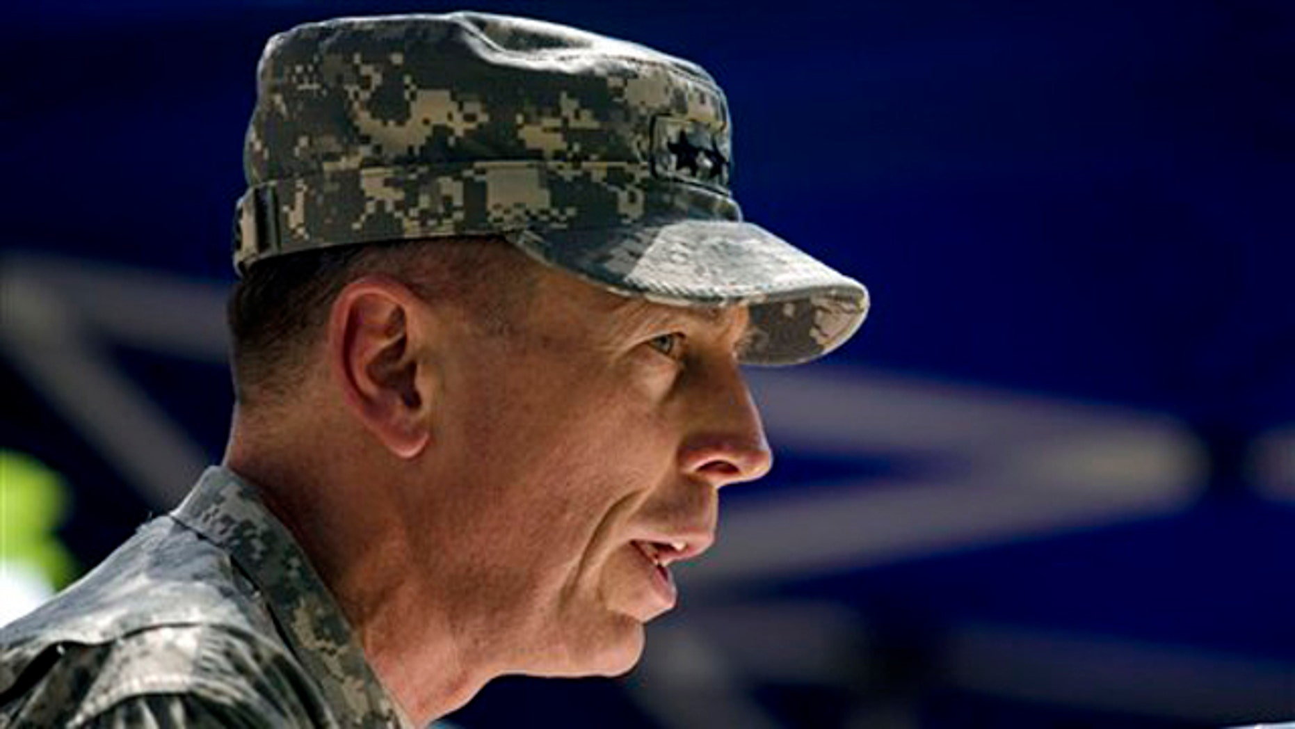 Gen. David Petraeus, the new commander of U.S. and NATO forces in Afghanistan, speaks during a ceremony July 4 in Kabul. (AP Photo)