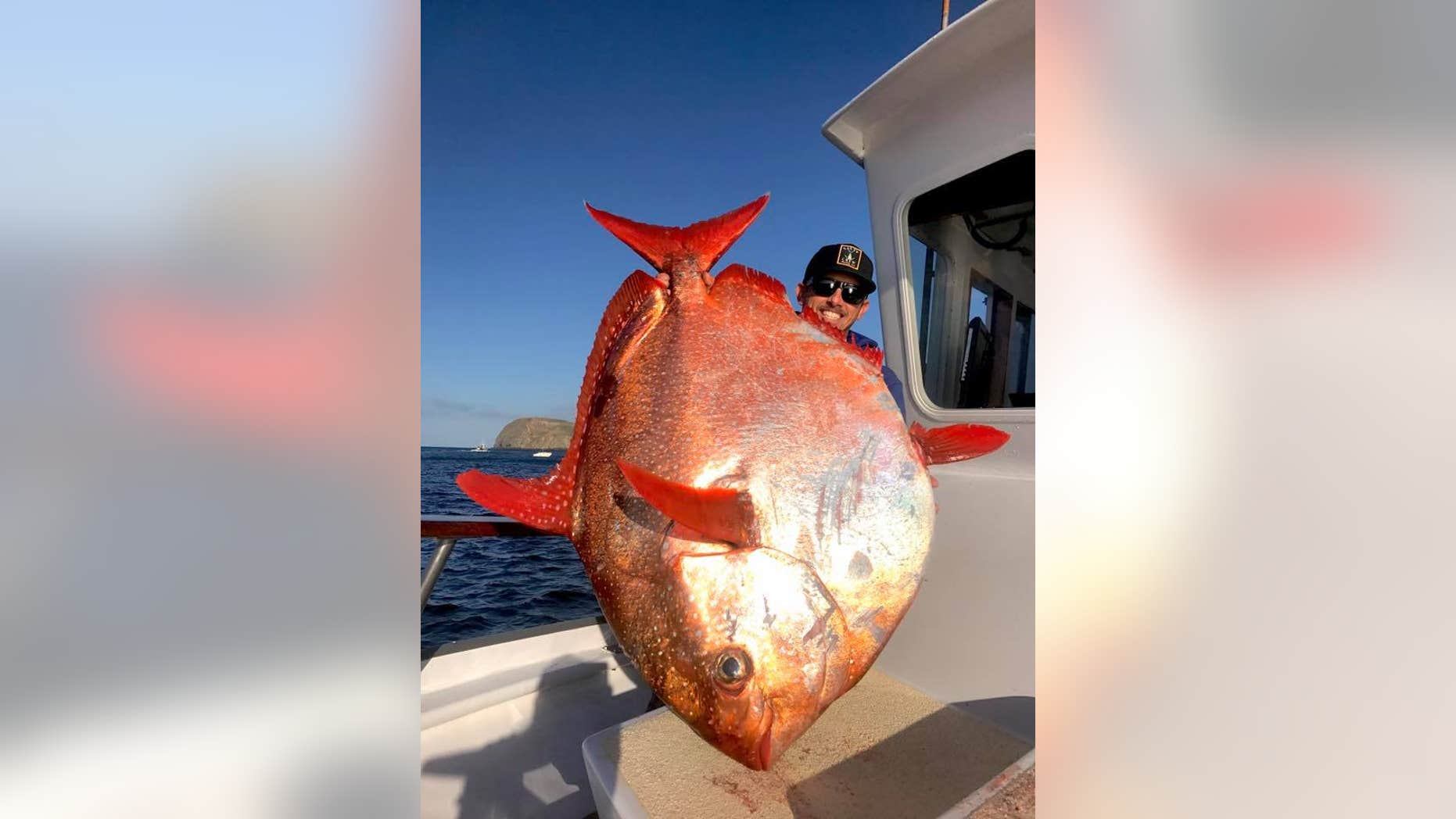 Shawn Steward of Oxnard, Calif., caught a rare 90-pound opah off Southern California.