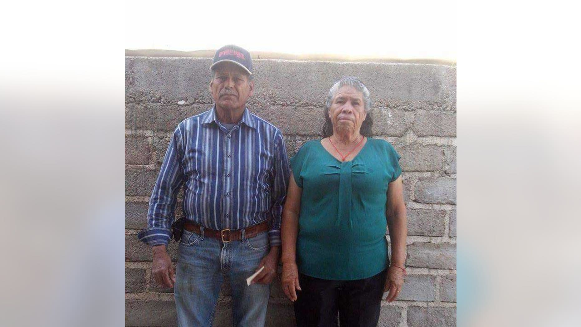 In this photo taken on Dec. 7, 2015,  and provided the Esparza family, Jose Isabel Esparza, 69, and his wife, Maria Esparza, 65, pose at their home on a farm in Cuachtemoc, Mexico, west of Mexico City. They have filed a lawsuit in U.S. District Court in Reno, Nevada against the U.S. State Department challenging denial of a visa for Maria to join her husband living and working in Nevada. They have been trying to obtain the visa since 1994. (Esparza Family via AP)