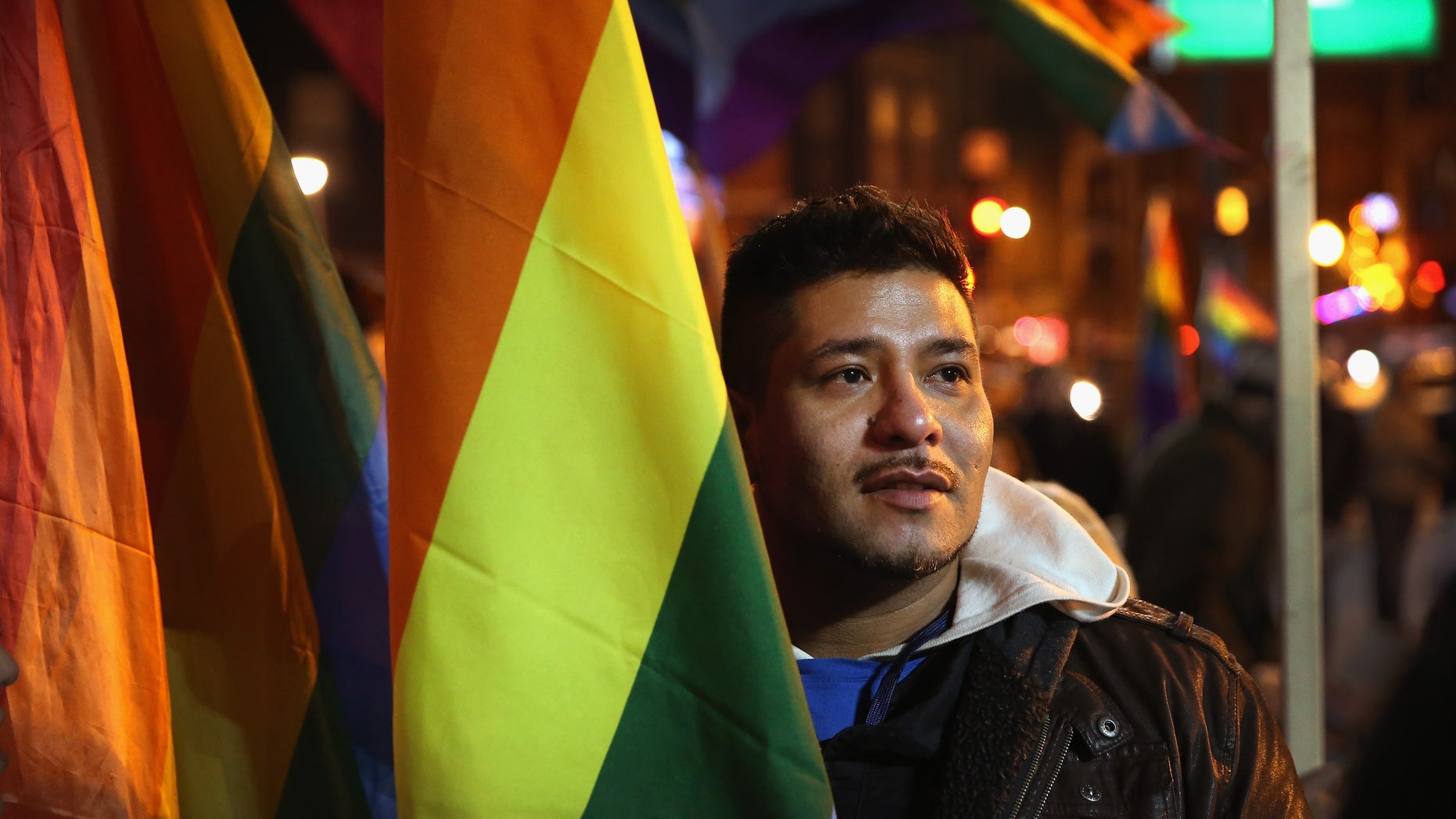 CHICAGO, IL - NOVEMBER 07:  Ismael Enriquez joins other supporters of same-sex marriage at a rally to celebrate Illinois General Assembly's passing of a gay marriage bill on November 7, 2013 in Chicago, Illinois. The governor is expected to sign the bill on November 20, making Illinois the 15th state to legalize same-sex unions.  (Photo by Scott Olson/Getty Images)