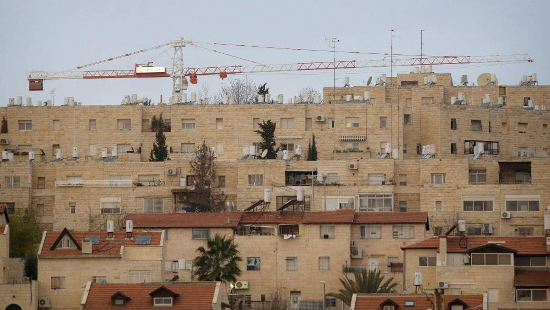 FILE - In this Jan. 16, 2011 file photo construction cranes are seen at the Jewish neighborhood of Gilo in Jerusalem. A Jerusalem city official says authorities have pushed forward plans to build 181 new homes in east Jerusalem Gilo area. srael captured east Jerusalem and the West Bank in 1967. Israel subsequently annexed east Jerusalem and considers areas like Gilo to be neighborhoods of its capital. The Palestinians claim east Jerusalem as their future capital, and most of the world considers settlement construction there and in the West Bank illegal or illegitimate. (AP Photo/Sebastian Scheiner, file)