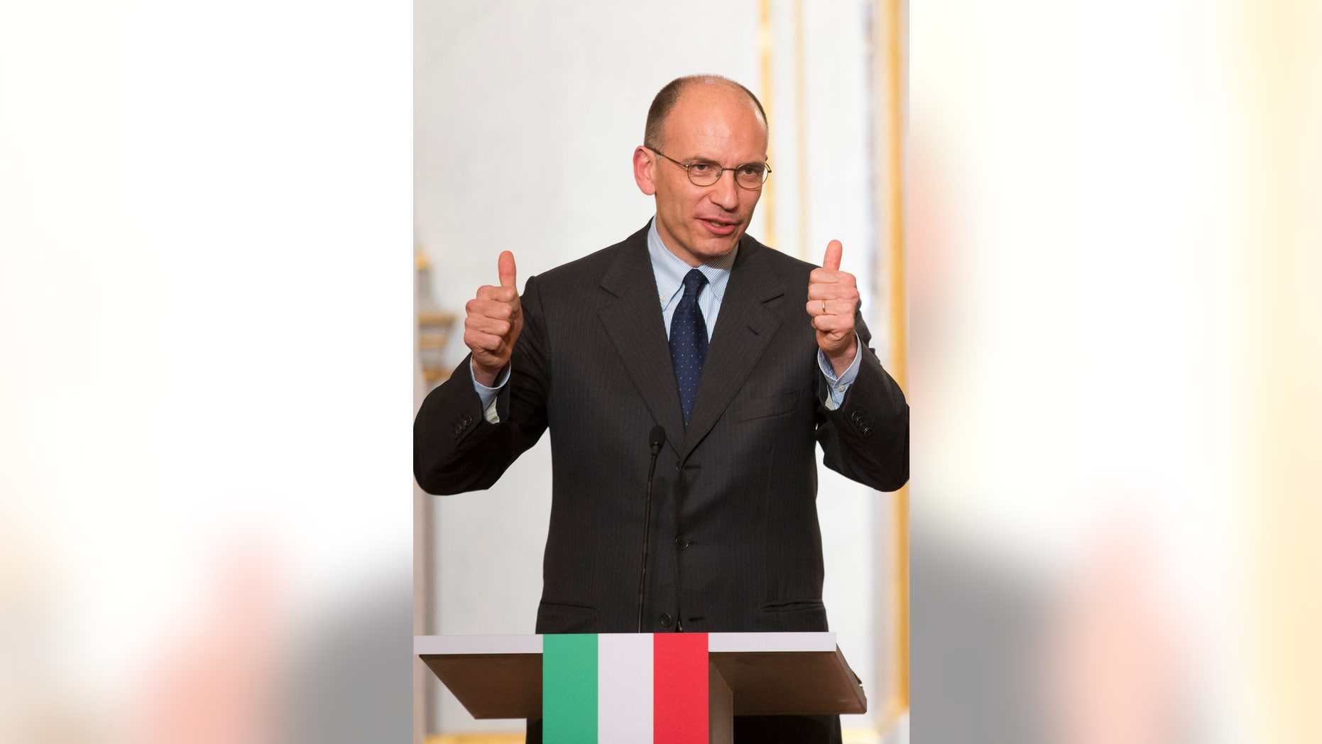 French President Francois Hollande, right, listens to Italy's Prime Minister Enrico Letta during  a press conference at the Elysee Palace in Paris, Wednesday, May 1, 2013.   (AP Photo/Jacques Brinon)