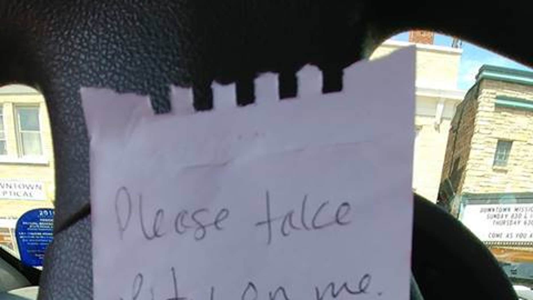 """A Wisconsin officer issued a """"pity"""" warning to a driver after finding a funny note left on the individual's car parked in an overdue meter spot. (Wausau Police Department)"""