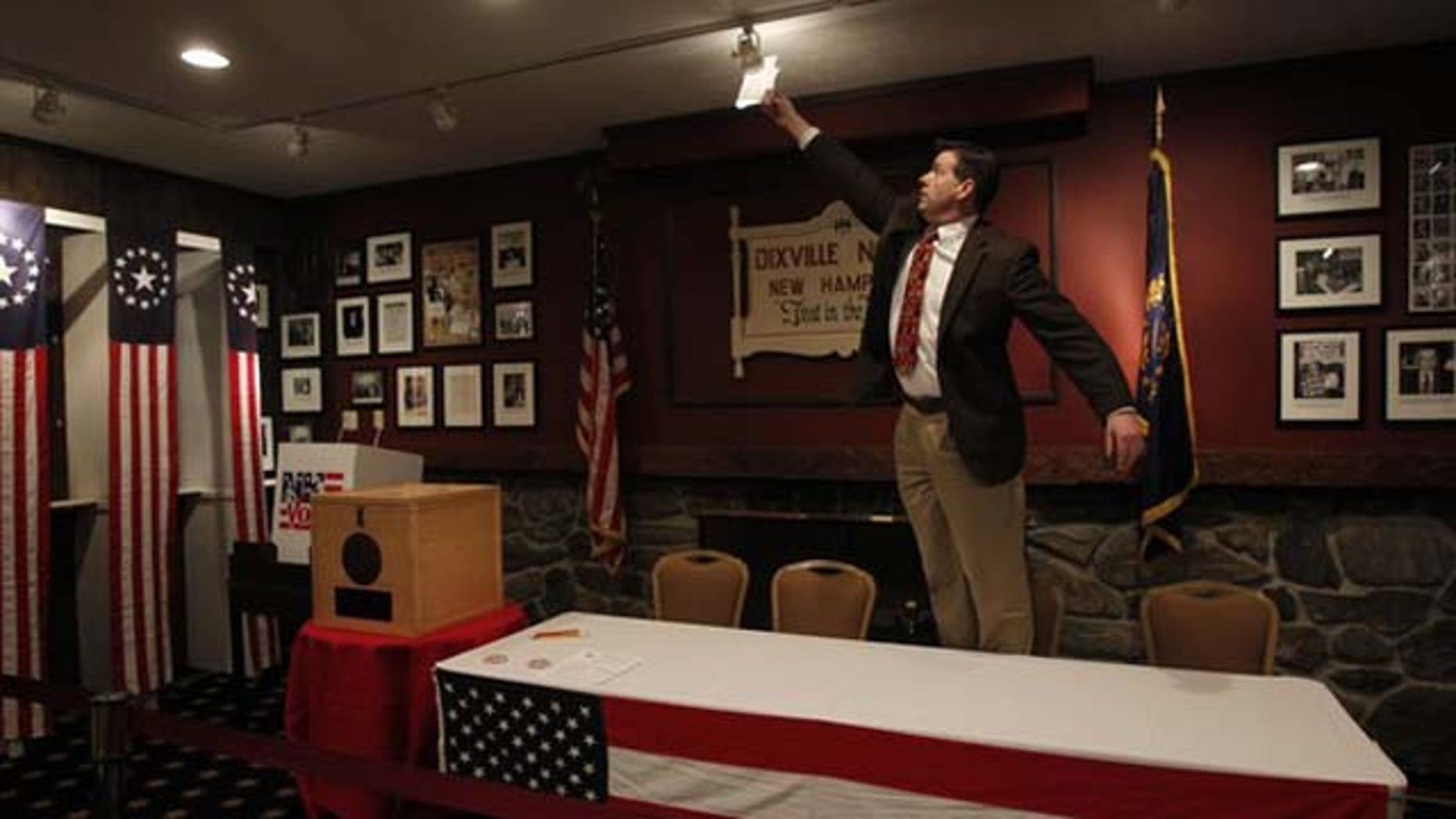 """January 10, 2012: Scott Trachemontagne adjusts a light in the """"Ballot Room"""" of the Balsams Hotel in Dixville Notch, New Hampshire."""